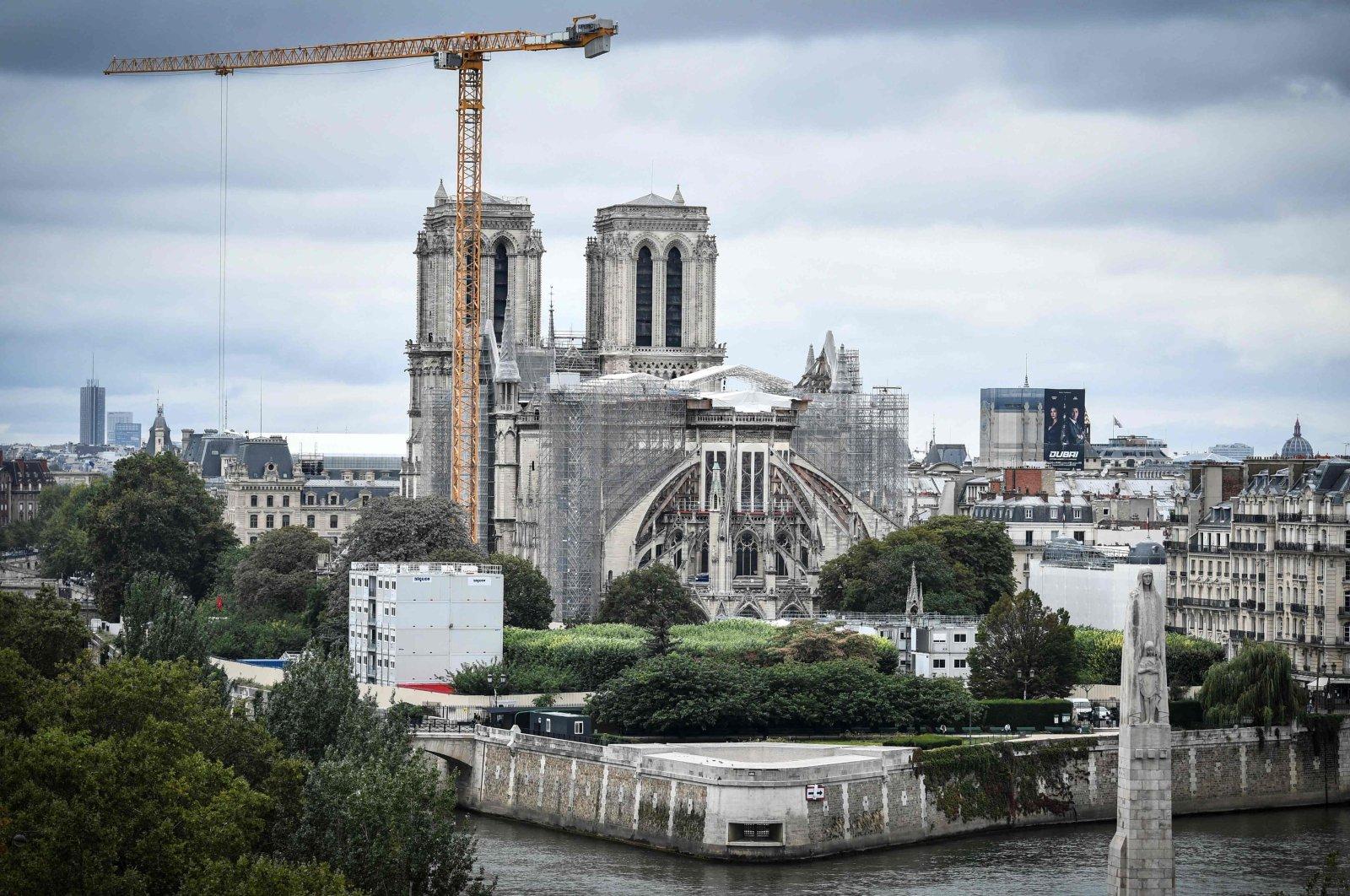A giant crane outside Notre-Dame Cathedral, Paris, France, Aug. 19, 2021. (AFP Photo)