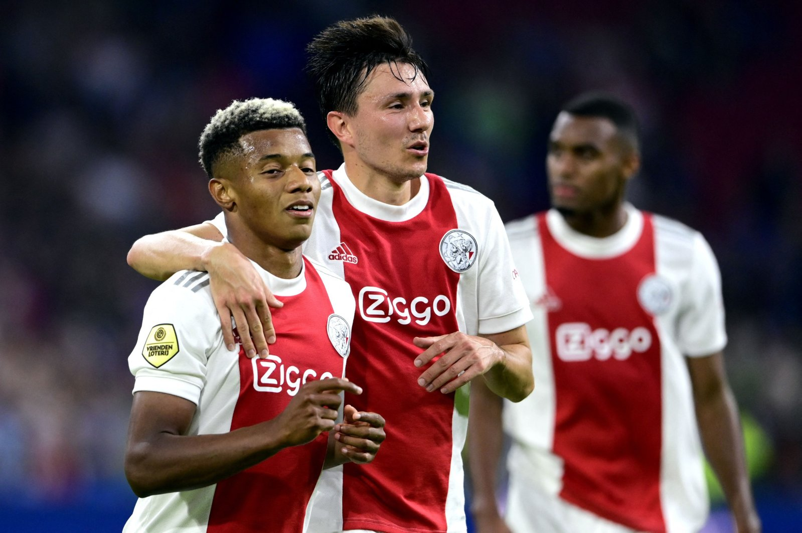 Ajax' Brazilian forward David Neres (L) and Dutch forward Steven Berghuis celebrate their fourth goal during the Dutch Eredivisie football match between Ajax Amsterdam and SC Cambuur at the Johan Cruijff ArenA in Amsterdam, Netherlands, Sept. 18, 2021. (AFP Photo)