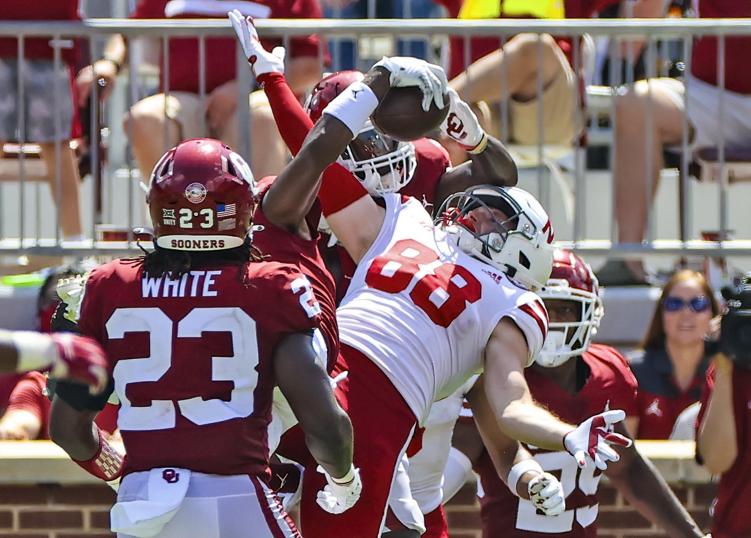 Oklahoma Sooners cornerback D.J. Graham (middle) makes an interception in front of Nebraska Cornhuskers wide receiver Levi Falck (88) during the fourth quarter at Gaylord Family-Oklahoma Memorial Stadium, Norman, Oklahoma, Sept. 18, 2021. (Kevin Jairaj-USA TODAY Sports via REUTERS)