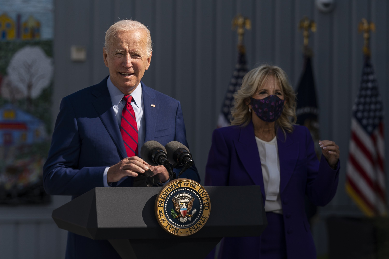 President Joe Biden, with first lady Jill Biden, speaks during a visit at Brookland Middle School in northeast Washington, D.C., U.S., Sept. 10, 2021. (AP Photo)