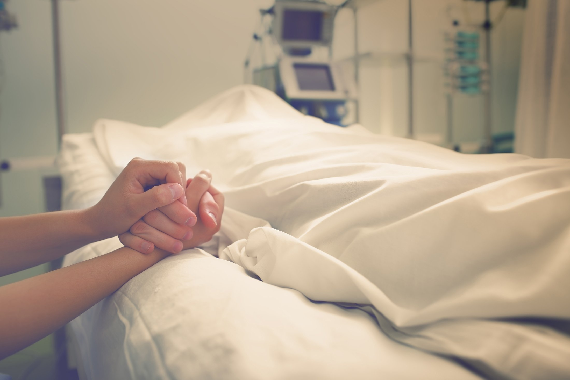 A woman mourns her husband, who died in a hospital. (Shutterstock Photo)
