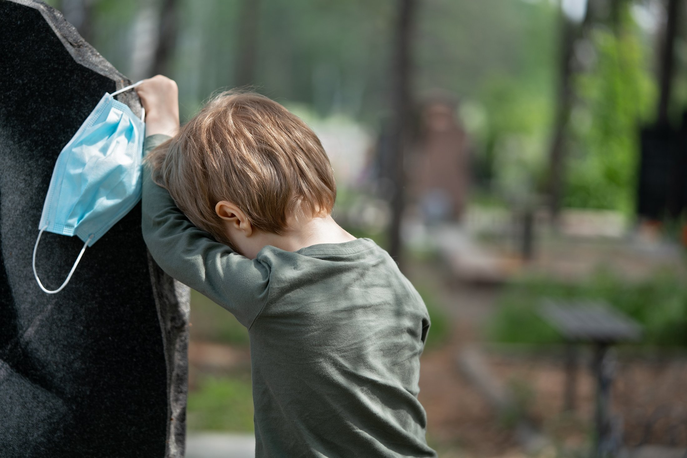 A little boy crying for the loss of his grandfather. (Shutterstock Photo)