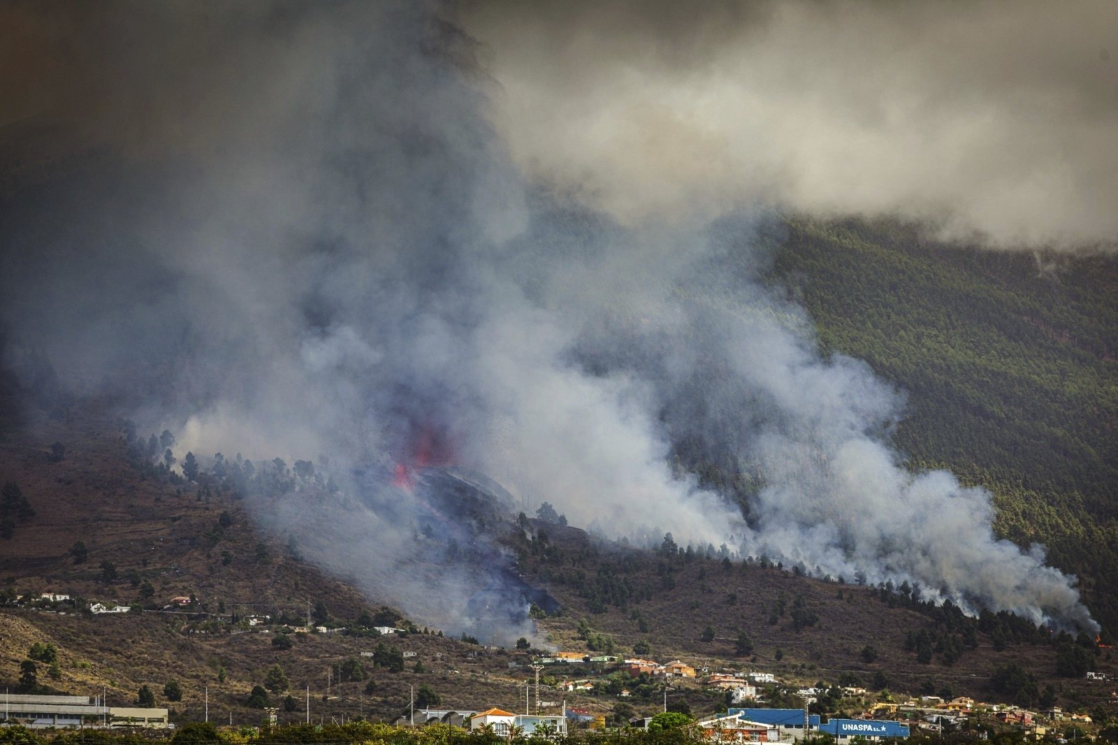 Smoke rises at the Cumbre Viegja volcanic on the island of La Palma in the Canaries, Spain, Sept. 19, 2021. (AP Photo)