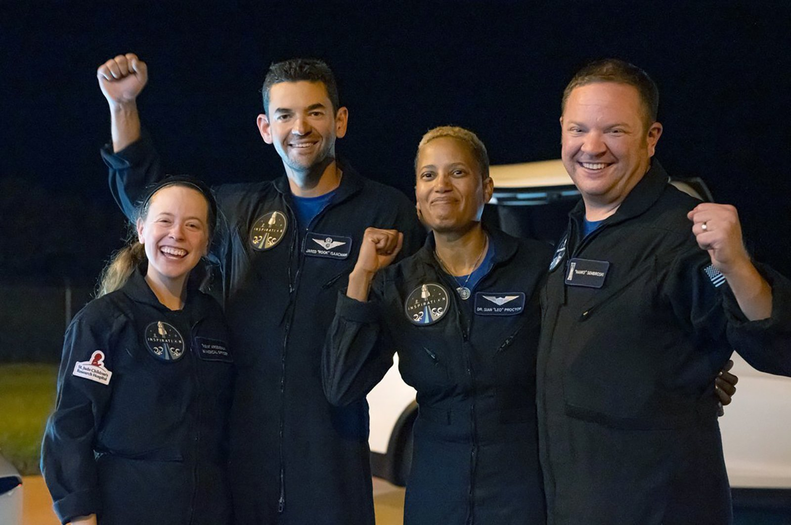 In this image released by Inspiration4, passengers aboard a SpaceX capsule, from left to right, Hayley Arceneaux, Jared Isaacman, Sian Proctor and Chris Sembroski pose after the capsule was recovered following its splashdown in the Atlantic off the Florida coast, Sept. 18, 2021. (Inspiration4 via AP)