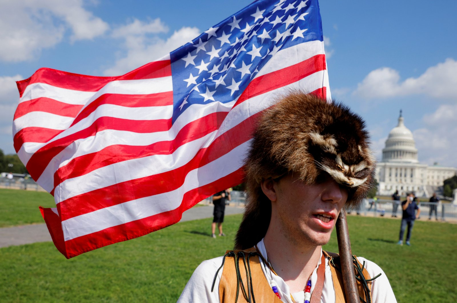 A man wearing a raccoon hat talks about his belief that former U.S. President Donald Trump won the election and that it was stolen from him through fraud, during a rally in support of defendants being prosecuted in the Jan. 6 attack on the Capitol, in Washington, D.C., U.S., Sept. 18, 2021. (REUTERS Photo)