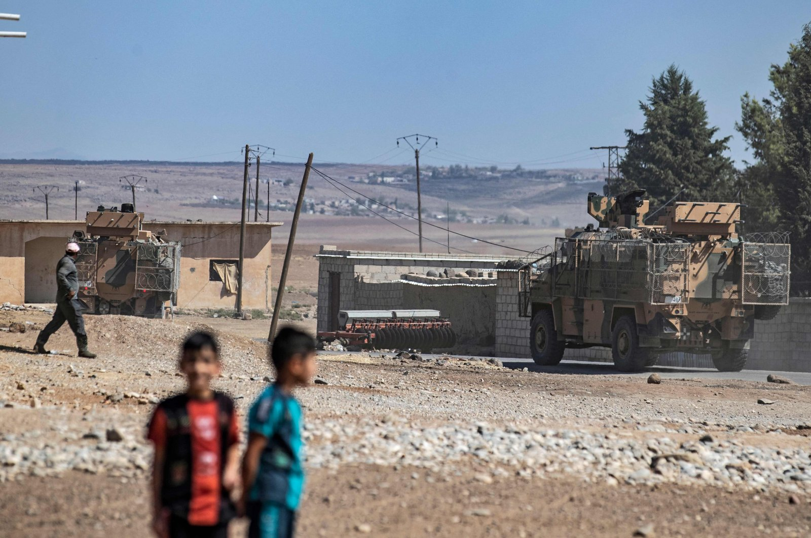Turkish and Russian military vehicles patrol in the countryside of Rumaylan (Rmelan) in Syria's northeastern Hassakeh province near the Turkish border, Sept. 16, 2021. (AFP Photo)