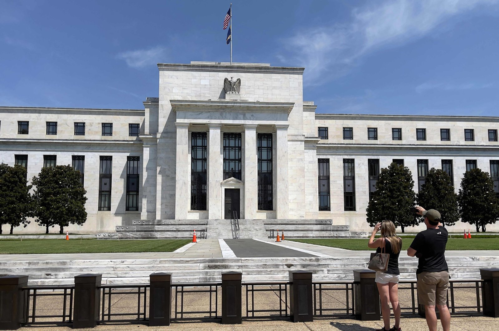 People take pictures of the U.S. Federal Reserve (Fed) building in Washington, D.C., U.S., Aug. 6, 2021. (AFP Photo)