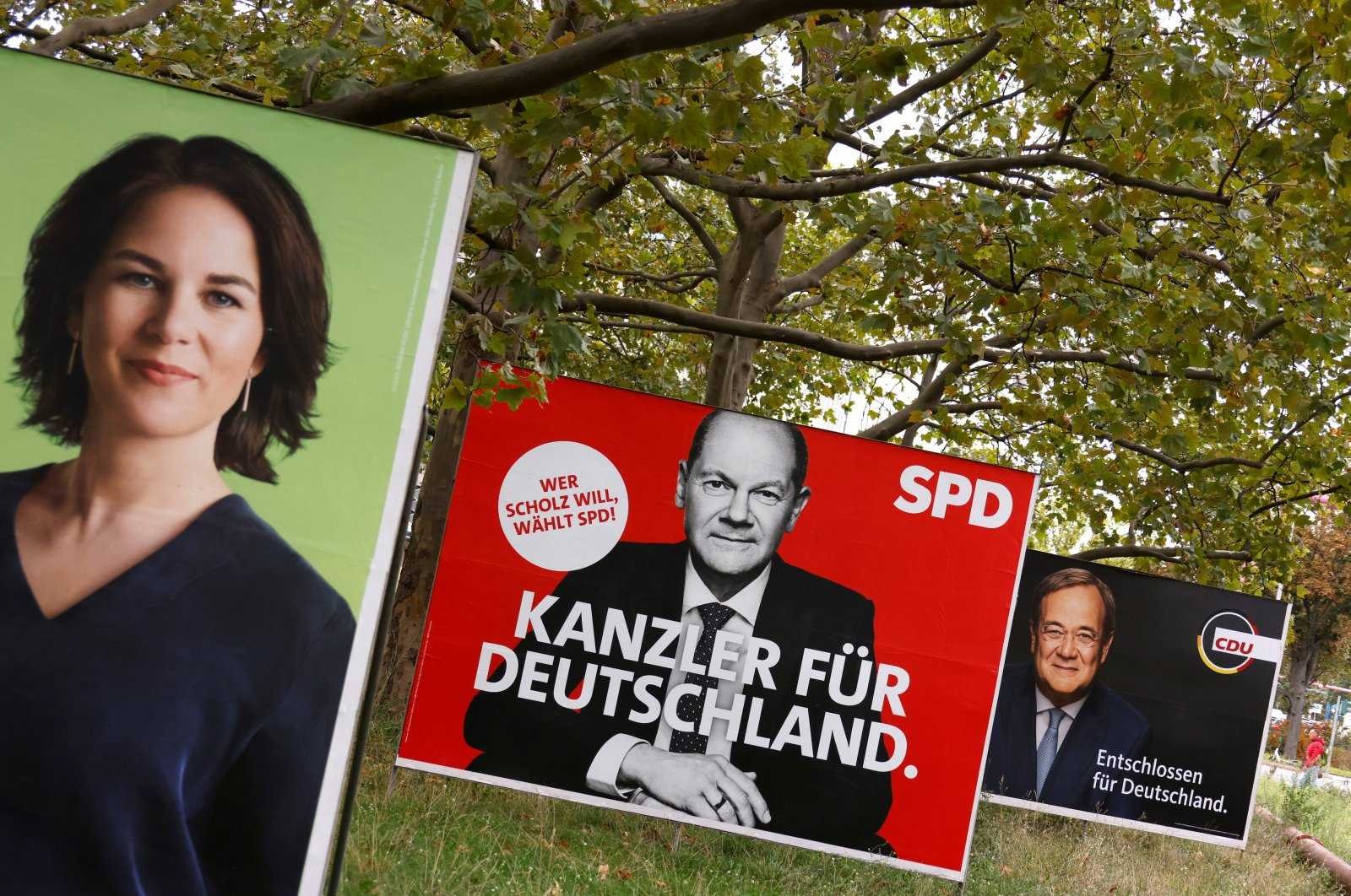 Election posters of Germany's top candidates for chancellor, Annalena Baerbock, co-leader of Germany's Green party, Olaf Scholz, German minister of finance of the Social Democratic Party (SPD) and Armin Laschet, North Rhine-Westphalia's state premier and Christian Democratic Union (CDU) leader, are pictured, in Berlin, Germany, Sept. 16, 2021.  (Reuters Photo)