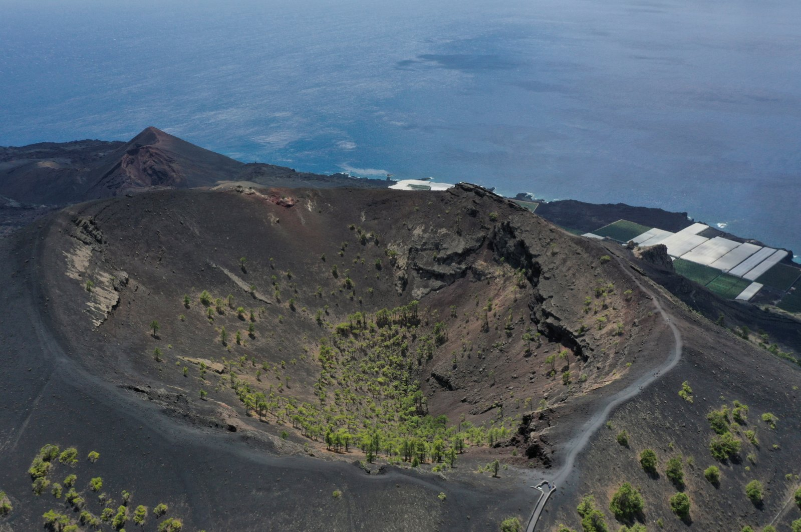 An aerial view of San Antonio Volcano in the foreground and Teneguia Volcano in the background, on the Canary Island of La Palma, Spain, Sept. 17, 2021. (Reuters Photo)