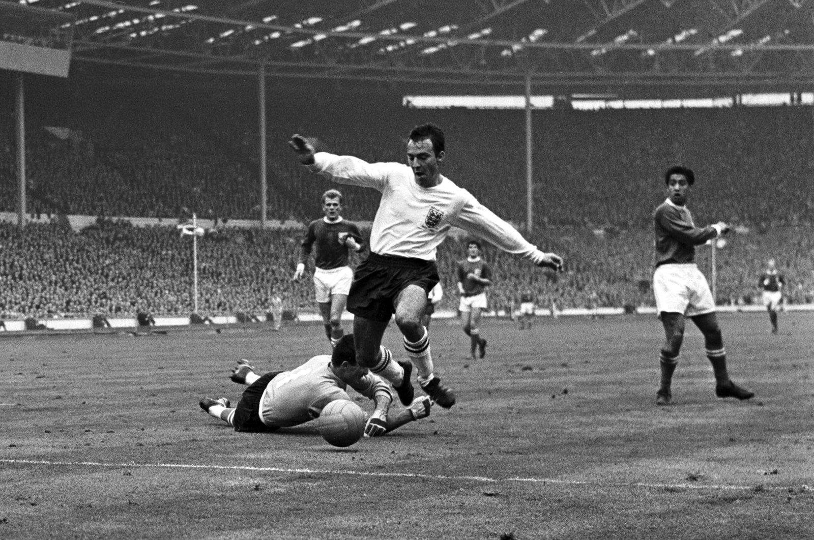 England striker Jimmy Greaves vies for the ball against Yugoslav goalkeeper Milutin Soskic during a Football Association match between England and the Rest of the World at Wembley Stadium, London, Oct. 23, 1965. (AP Photo)
