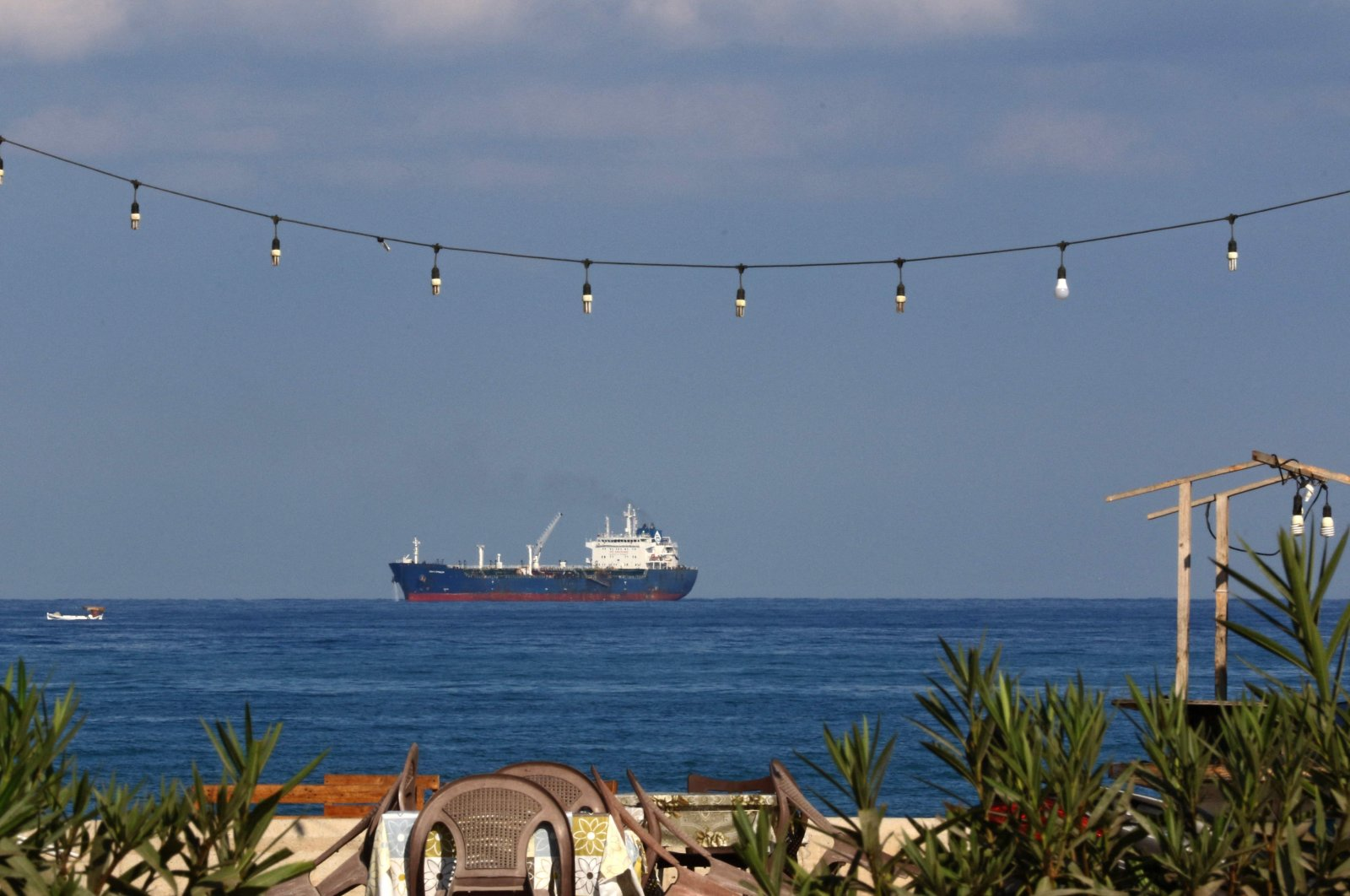 An oil tanker carrying fuel oil from Iraq, is seen anchored near the Zahrani power plant in Zahrani near the southern Lebanese city of Saida, Sept. 18, 2021. (AFP Photo)