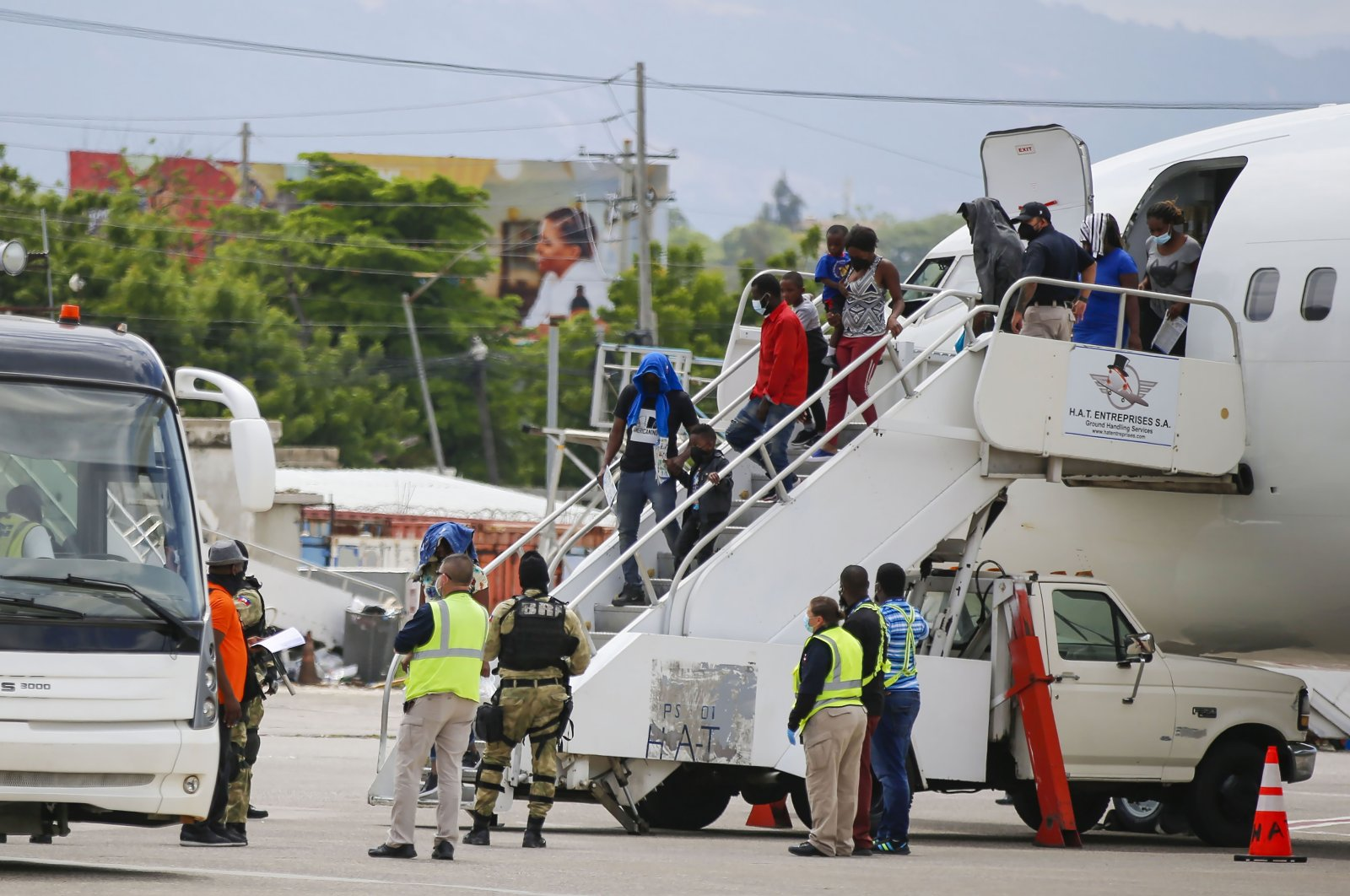 Haitians who were deported from the United States deplane at the Toussaint Louverture International Airport, in Port au Prince, Haiti, Sept. 19, 2021. (AP Photo)