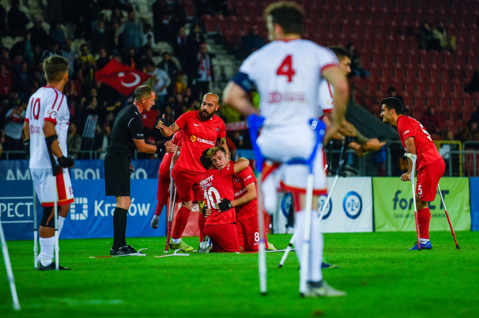 Turkishnational amputee football team players celebrate after scoring a goal against Spain,at the Cracovia Stadium in Krakow, Poland, Sept. 19, 2021. (AA Photo)