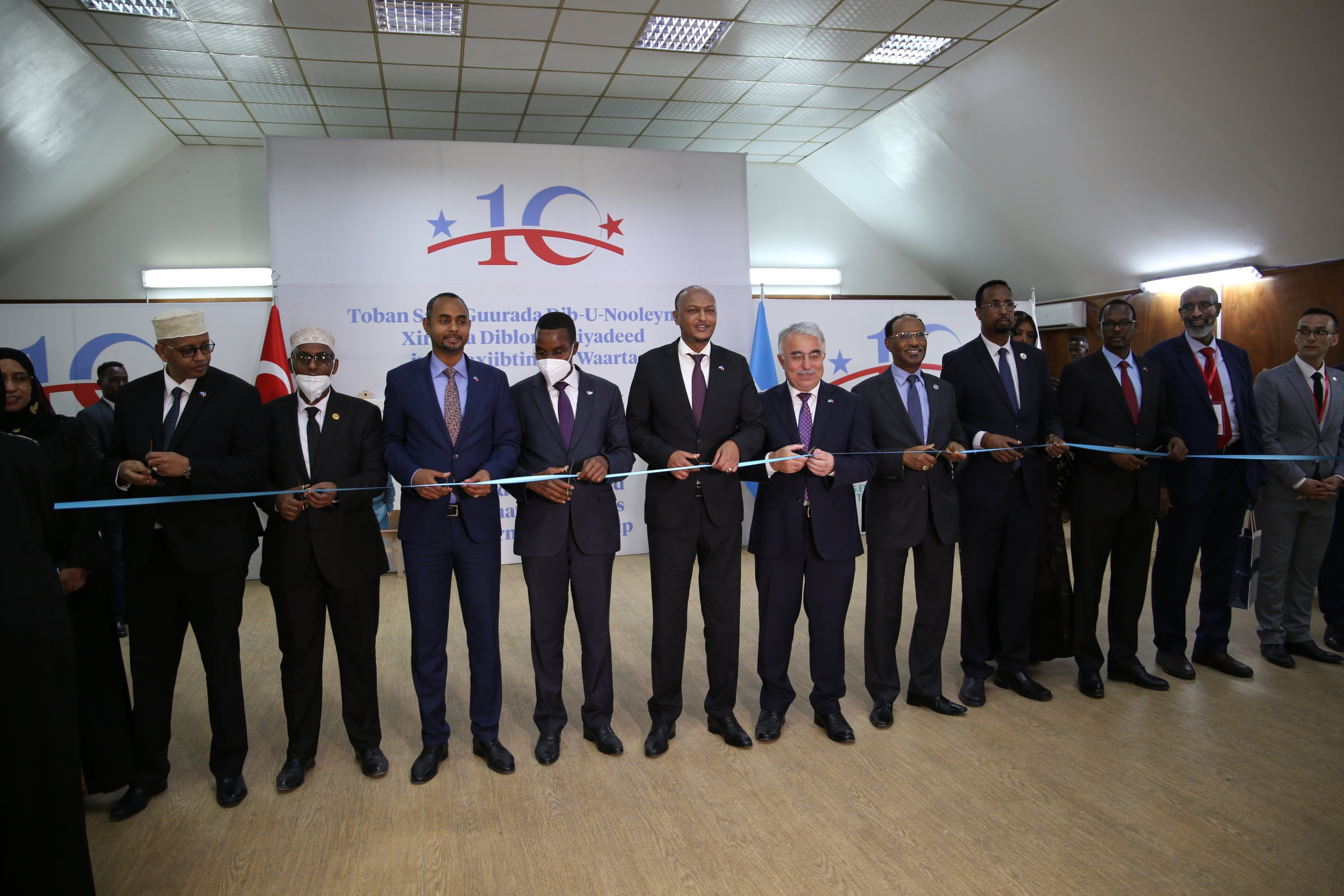 Officials cut a ribbon during a ceremony to mark 10 years of Turkish and Somali relations, in Mogadishu, Somalia, Aug. 19, 2021. (AA Photo)