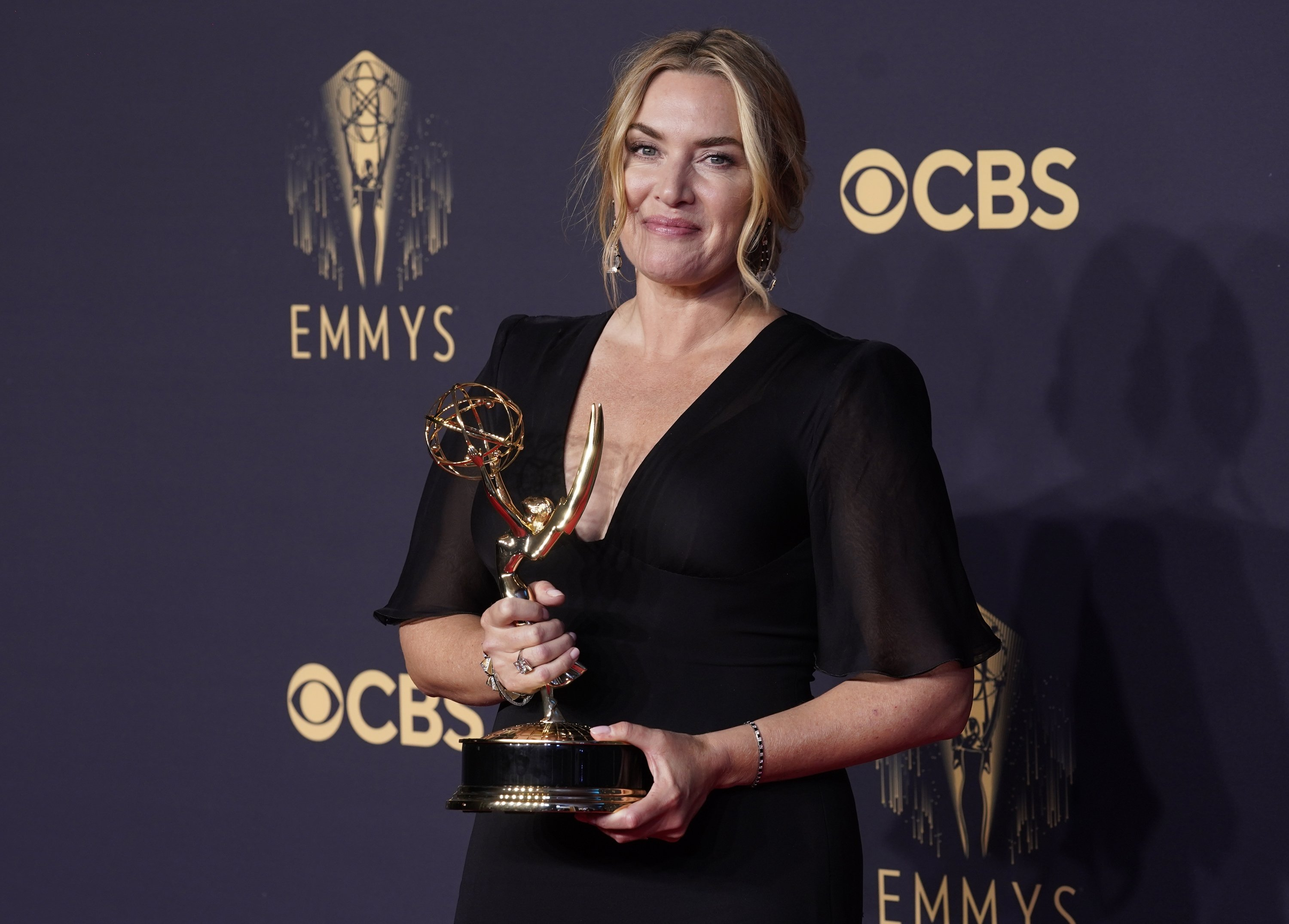 Kate Winslet, winner of the award for outstanding lead actress in a limited or anthology series or movie for 'Mare of Easttown,' poses at the 73rd Primetime Emmy Awards at L.A. Live in Los Angeles, California, U.S., Sept. 19, 2021. (AP Photo)