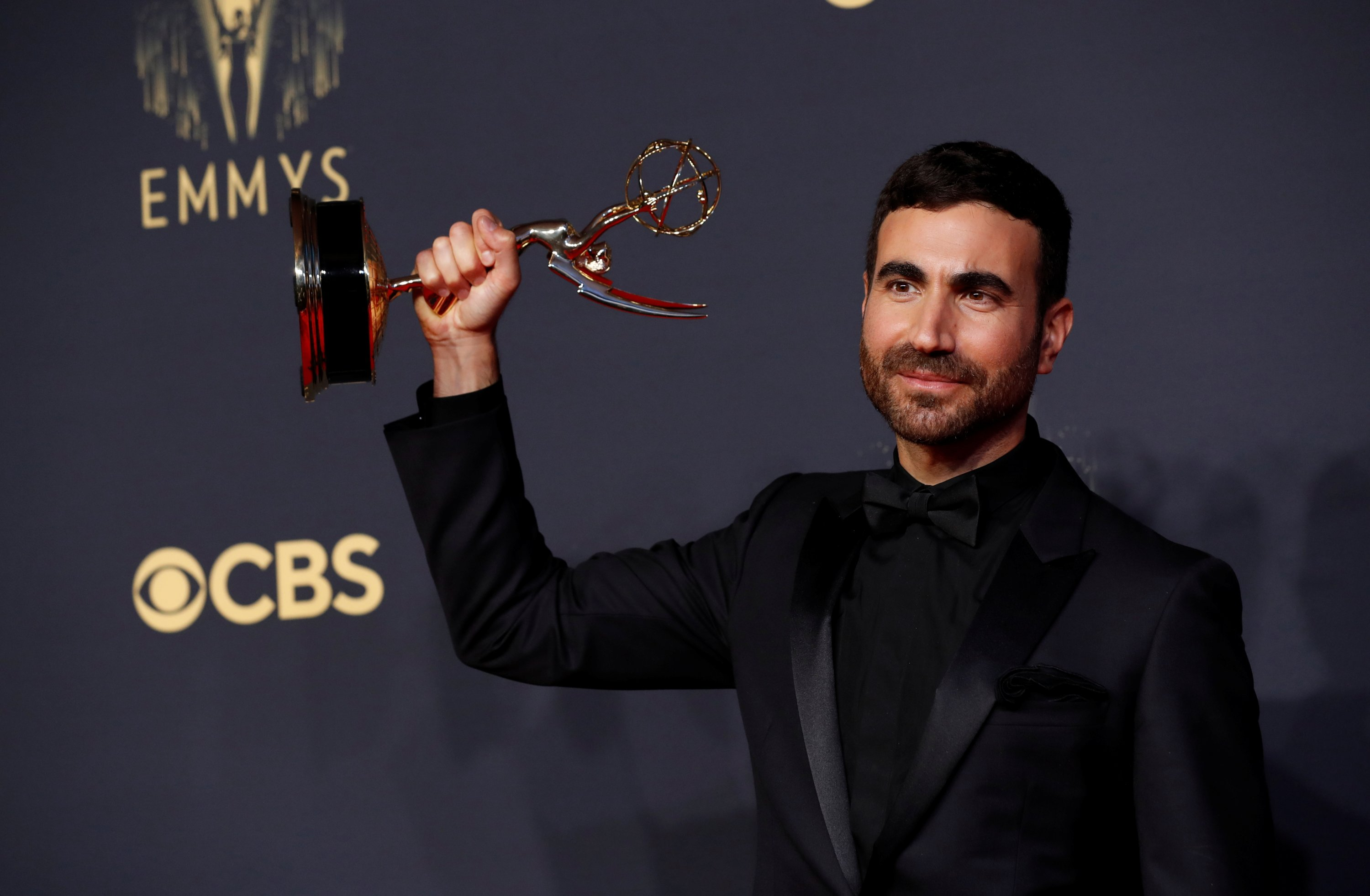 Brett Goldstein poses for a picture with the award for outstanding supporting actor in a comedy series, for 'Ted Lasso,' at the 73rd Primetime Emmy Awards at L.A. Live in Los Angeles, California, U.S., Sept. 19, 2021. (AP Photo)