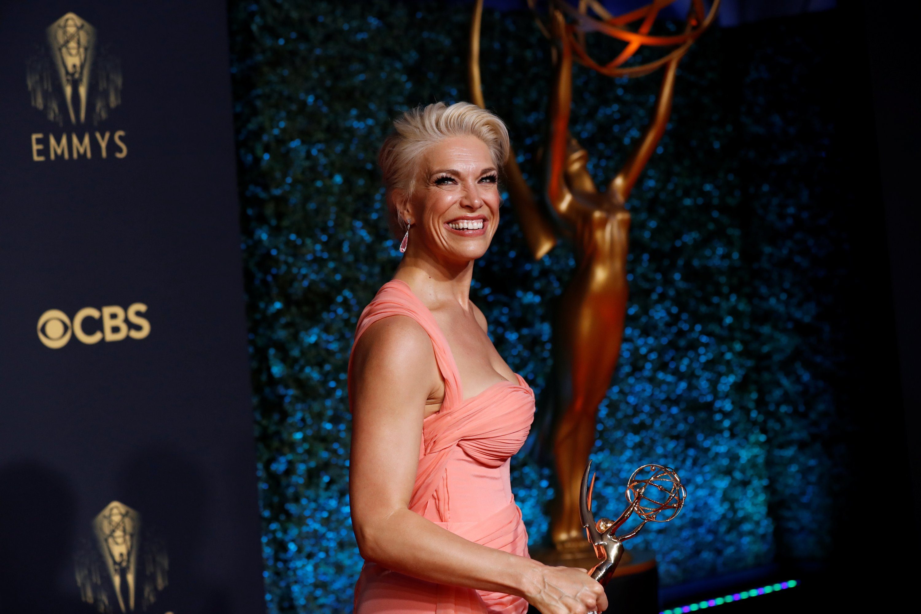 Hannah Waddingham laughs as she poses with her award for outstanding supporting actress in a comedy series, for 'Ted Lasso,' at the 73rd Primetime Emmy Awards at L.A. Live in Los Angeles, California, U.S., Sept. 19, 2021. (AP Photo)