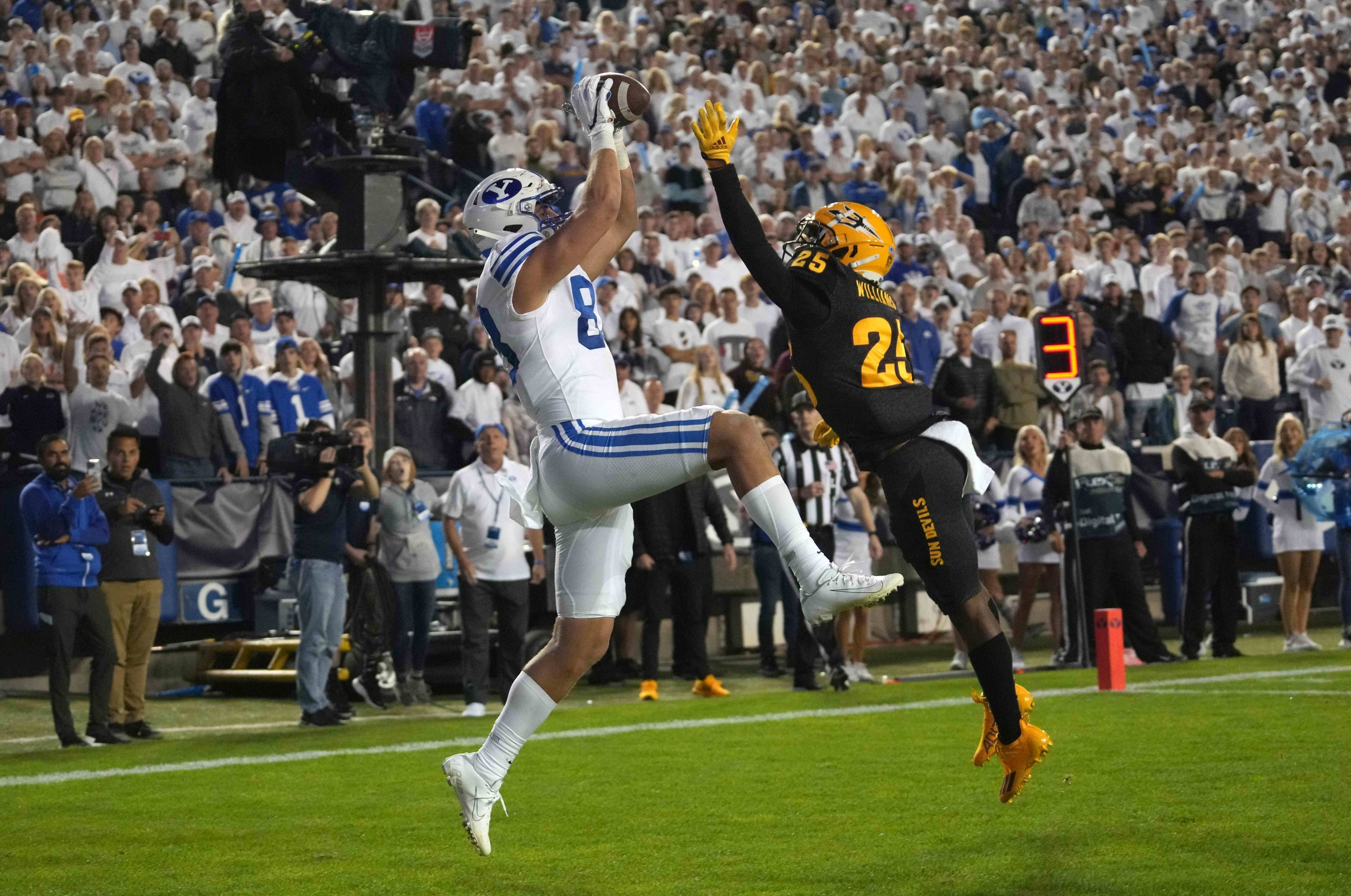 BYU Cougars tight end Isaac Rex (83) is defended by Arizona State Sun Devils defensive back Macen Williams (25) on a 3-yard touchdown reception in the fourth quarter at LaVell Edwards Stadium, Provo, Utah, U.S., Sept. 18, 2021. (Kirby Lee-USA TODAY Sports via Reuters)
