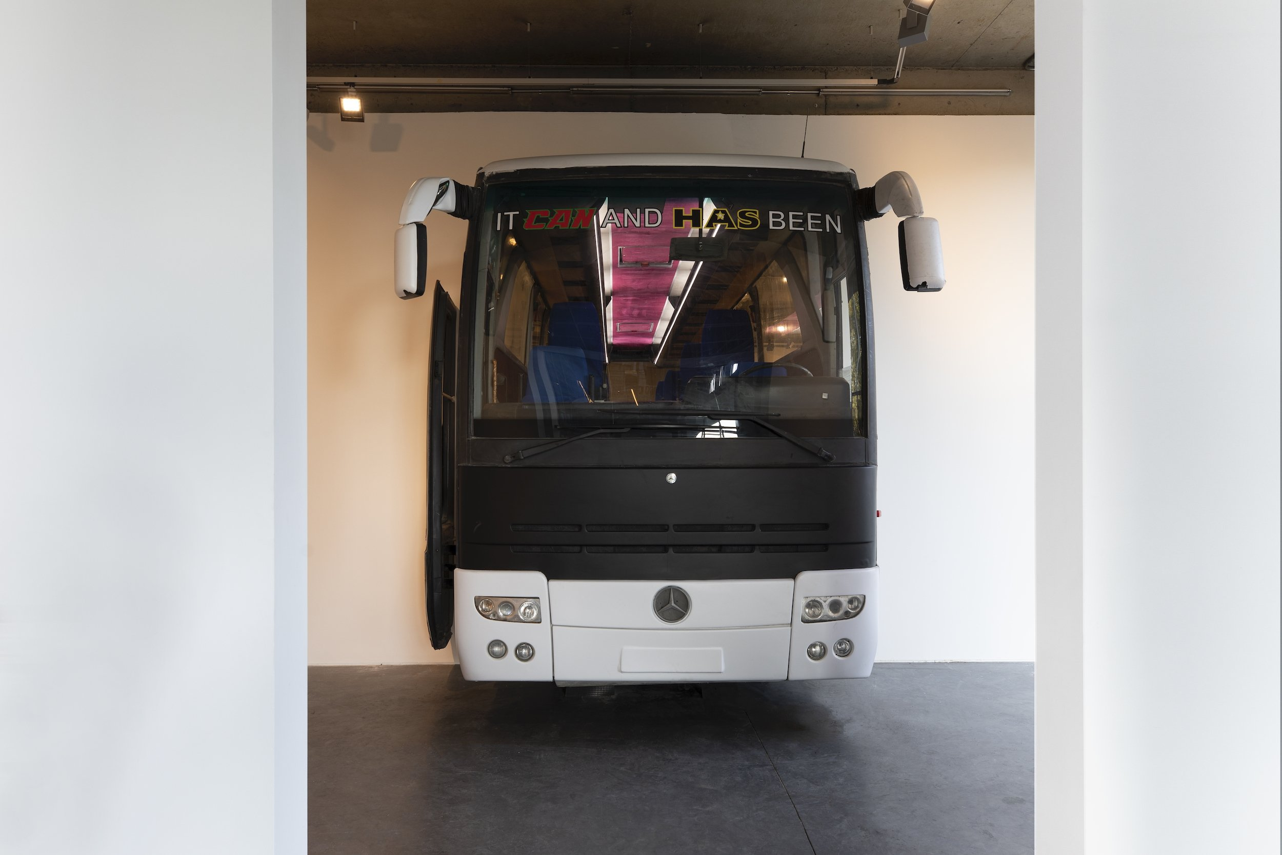 Ahmet Öğüt's bus at 'It Can and Has Been' (2021). (Courtesy of Dirimart)