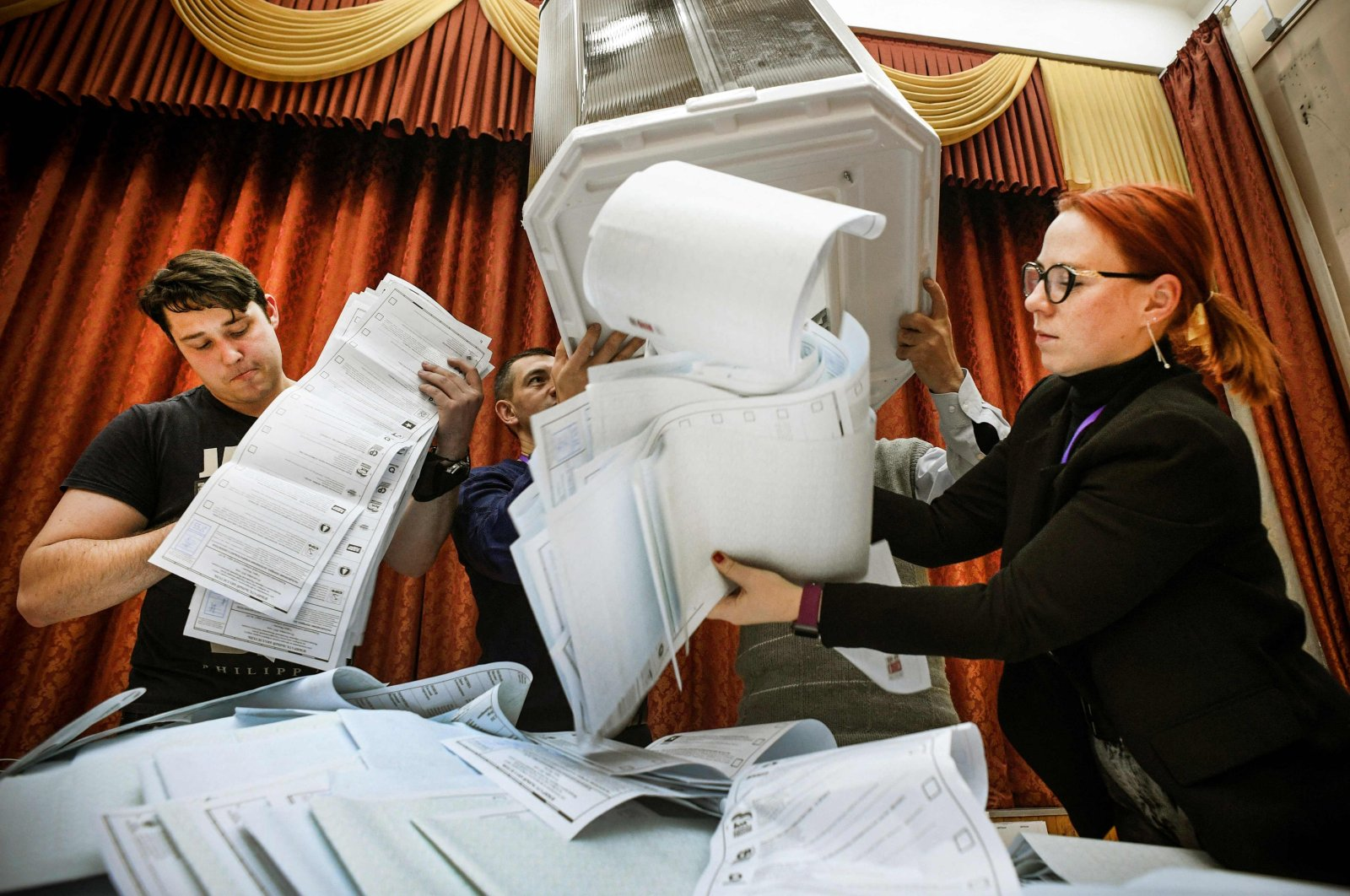 Members of a local electoral commission empty a ballot box at a polling station after the last day of the three-day parliamentary election, in Moscow, Russia, Sept. 19, 2021. (AFP Photo)