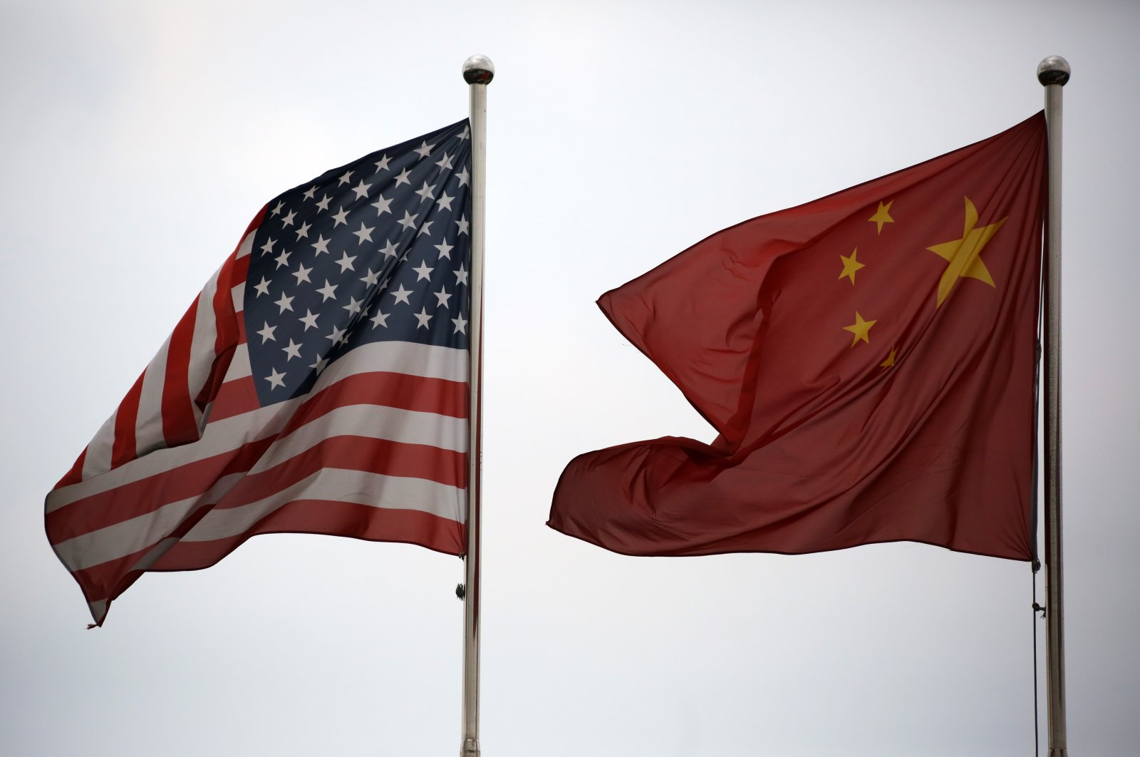 U.S. and Chinese national flags fly outside a company building in the China Pilot Free Trade Zone's Waigaoqiao free trade zone and logistics park in Shanghai, China, Oct. 22, 2013. (Bloomberg via Getty Images)