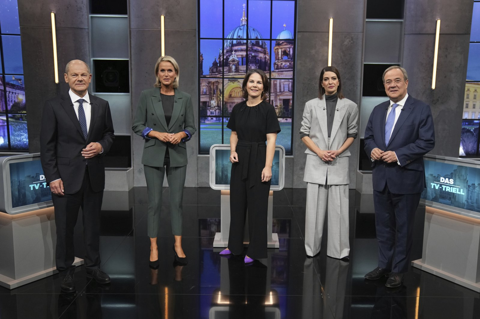 Olaf Scholz, candidate for chancellor of the SPD and Federal Minister of Finance, (L), Claudia von Brauchitsch, moderator, (2nd L), Annalena Baerbock, German Green Party co-leader and candidate for chancellor, (C) , Linda Zervakis, moderator, and Armin Laschet, candidate for chancellor of the CDU/CSU and chairman of the CDU, (R) , stand together before the start of the third TV debate in Berlin, Germany, Sept. 19, 2021. (AP Photo)