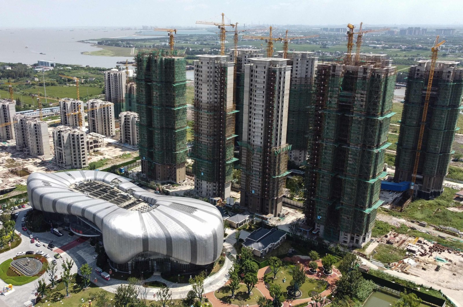 The halted under-construction Evergrande Cultural Tourism City, a mixed-used residential-retail-entertainment development, in Taicang, Suzhou city, in China's eastern Jiangsu province, Sept. 17, 2021. (AFP Photo)