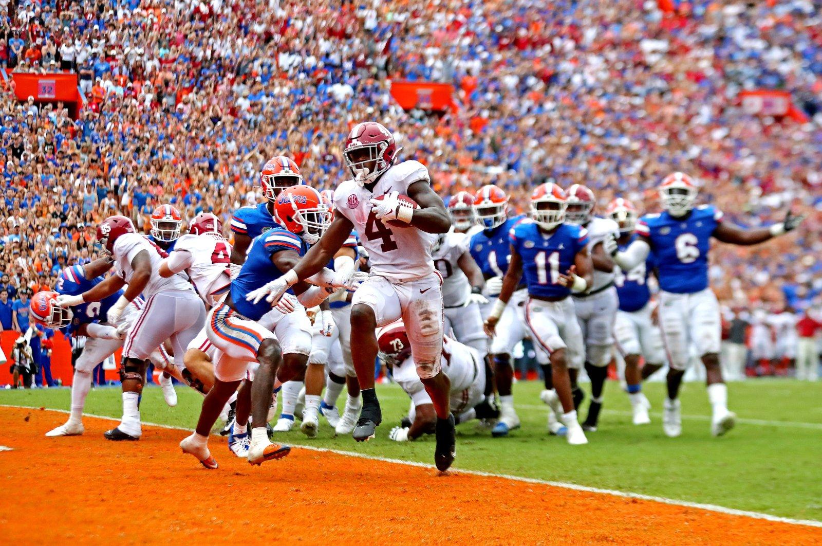 Alabama Crimson Tide running back Brian Robinson Jr. (4) scores a touchdown during the third quarter against the Florida Gators at Ben Hill Griffin Stadium, Gainesville, Florida, U.S., Sept. 18, 2021. (Mark J. Rebilas-USA TODAY Sports via Reuters)