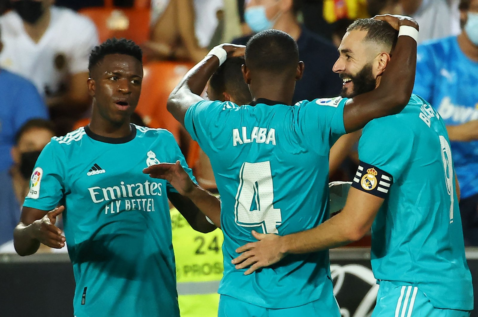 Real Madrid's Karim Benzema (R) celebrates scoring his team's second goal with teammate David Alaba and Vinicius Junior (L) during a La Liga match against Valencia, in Valencia, Spain, Sept. 19, 2021. (AFP Photo)
