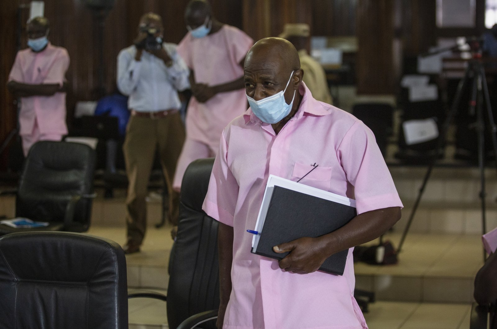 """Paul Rusesabagina, who inspired the film """"Hotel Rwanda"""" and is credited with saving more than 1,000 people by sheltering them at the hotel he managed during the genocide, attends a court hearing in Kigali, Rwanda, Feb. 26, 2021. (AP Photo)"""