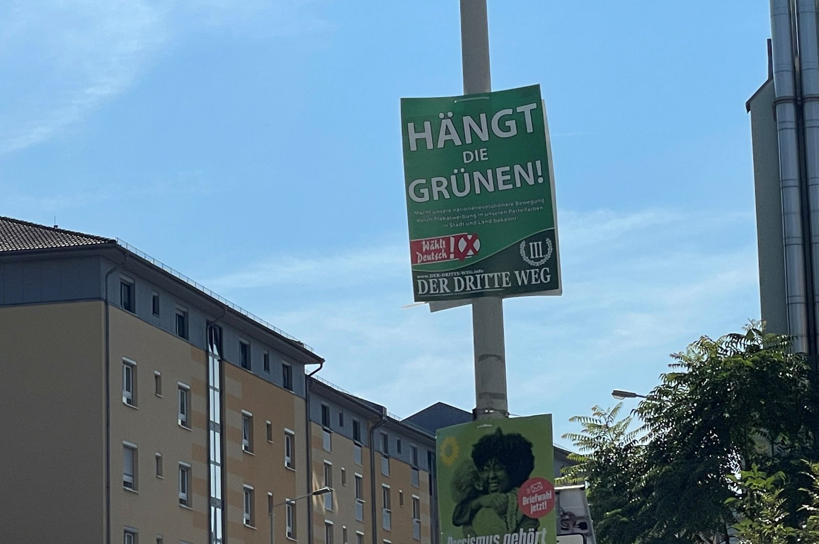 """An election poster saying """"Hang The Greens,"""" placed by Der Dritte Weg, a far-right party with suspected links to neo-Nazi groups, in Zwickau, Germany, Sept. 8, 2021. (Radio Zwickau Handout via Reuters)"""