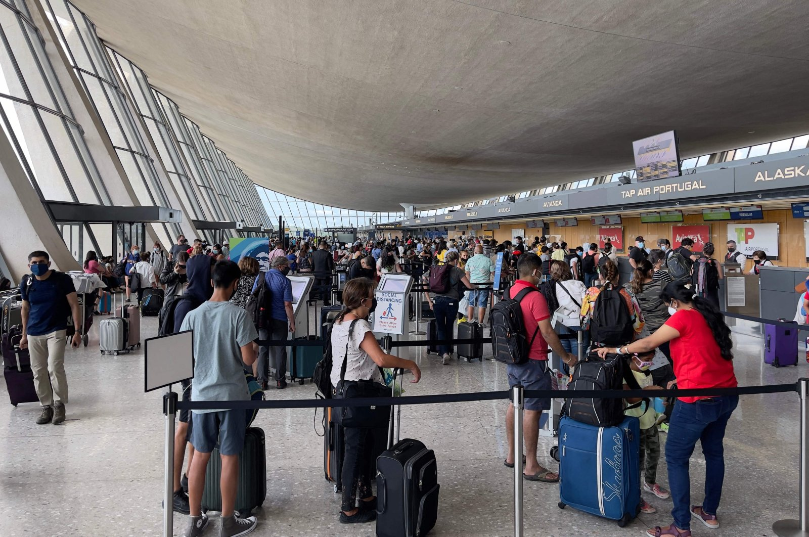 Passengers are seen at Dulles Washington International Airport (IAD) in Dulles, Virginia, U.S., Aug. 14, 2021. (AFP Photo)