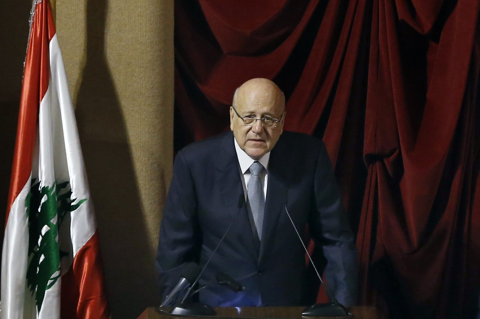 Lebanese Prime Minister Najib Mikati speaks during a parliament session to confirm Lebanon's new government at a Beirut theater known as the UNESCO palace, Lebanon, Monday, Sept. 20, 2021.(AP Photo)