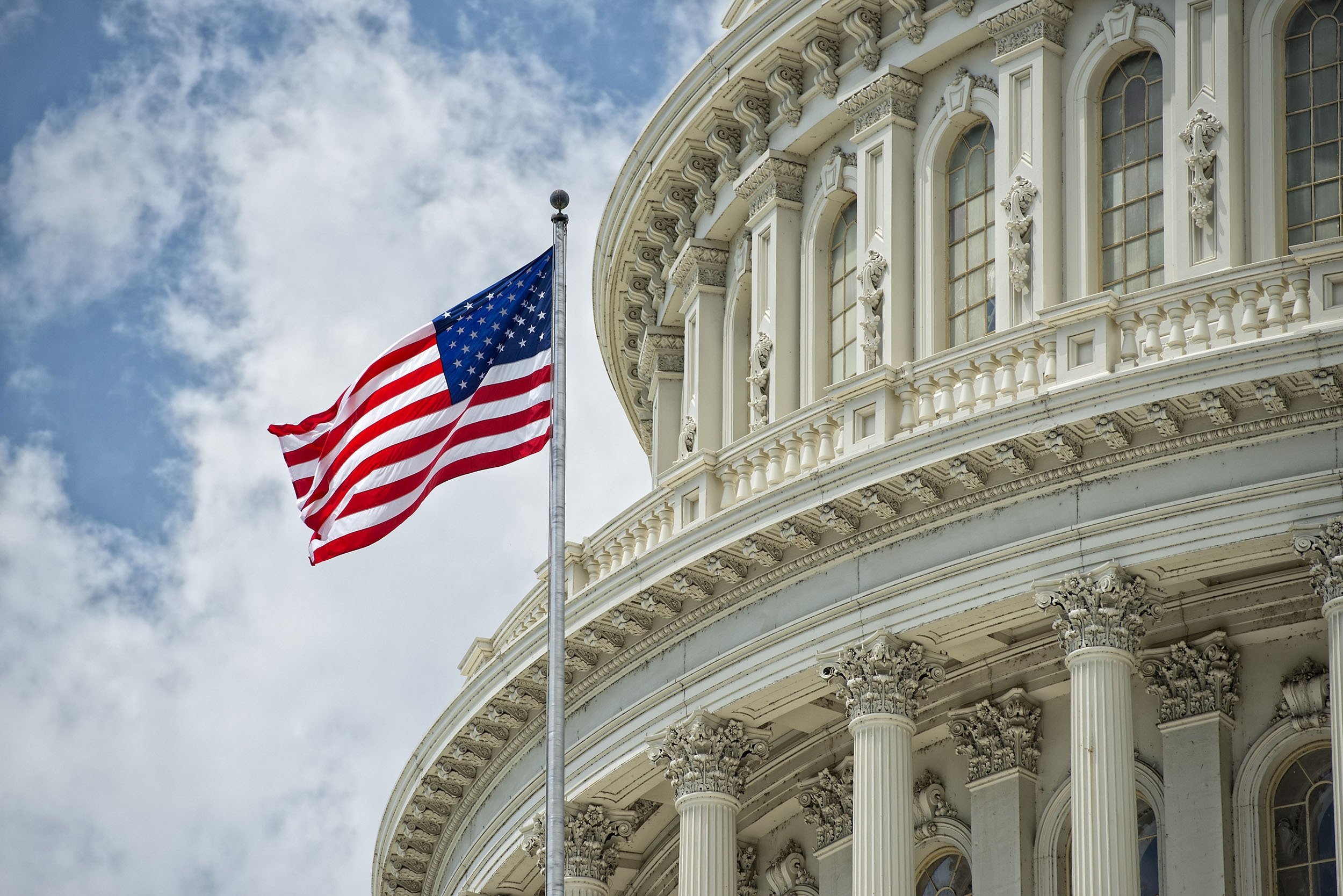 The U.S. flag flutters on the Capitol building in Washington, D.C., U.S. (Shutterstock Photo)