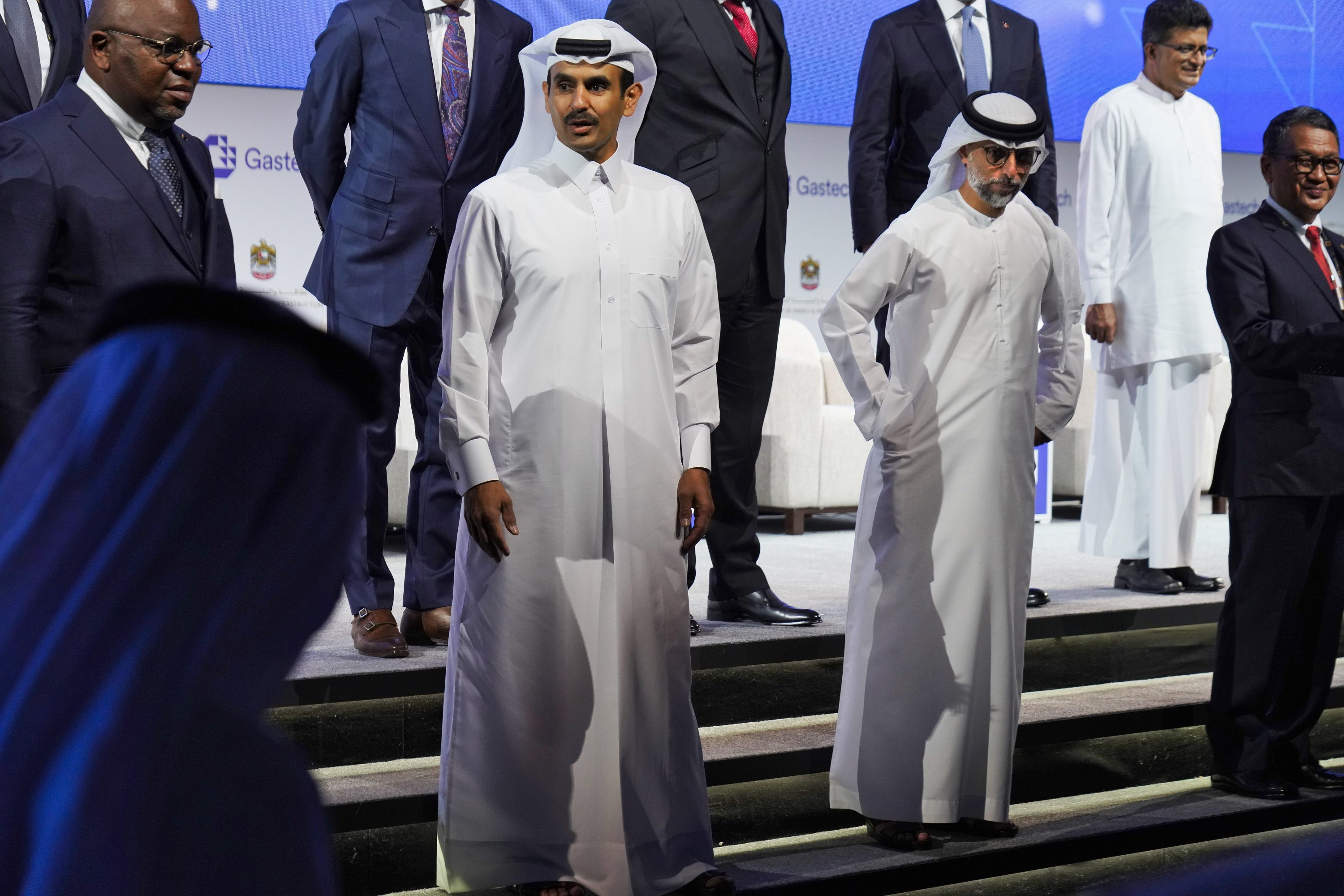 Qatar's Minister of State for Energy Affairs Saad Sherida al-Kaabi (CL), awaits a posed portrait with Emirati Energy and Infrastructure Minister Suhail al-Mazrouei (CR) during Gastech 2021 conference in Dubai, United Arab Emirates, Sept. 21, 2021. (AP Photo)
