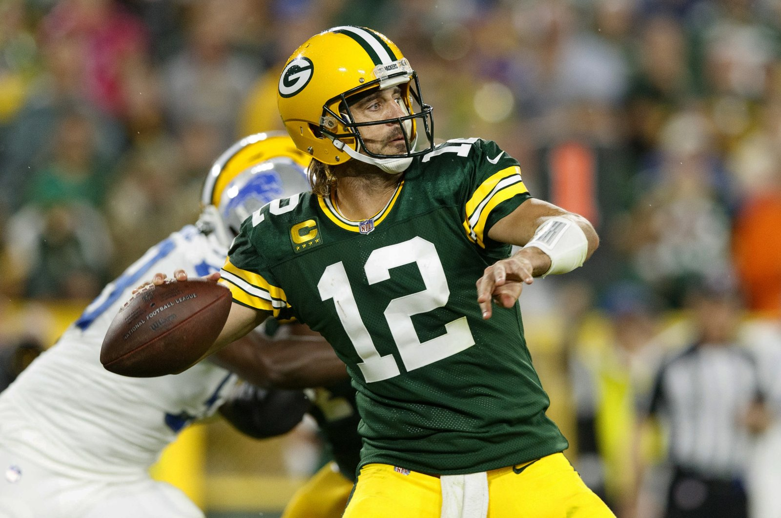 Green Bay Packers quarterback Aaron Rodgers (12) throws a pass against the Detroit Lions during the third quarter at Lambeau Field, Green Bay, Wisconsin, U.S., Sept. 20, 2021. (Jeff Hanisch-USA TODAY Sports via REUTERS)
