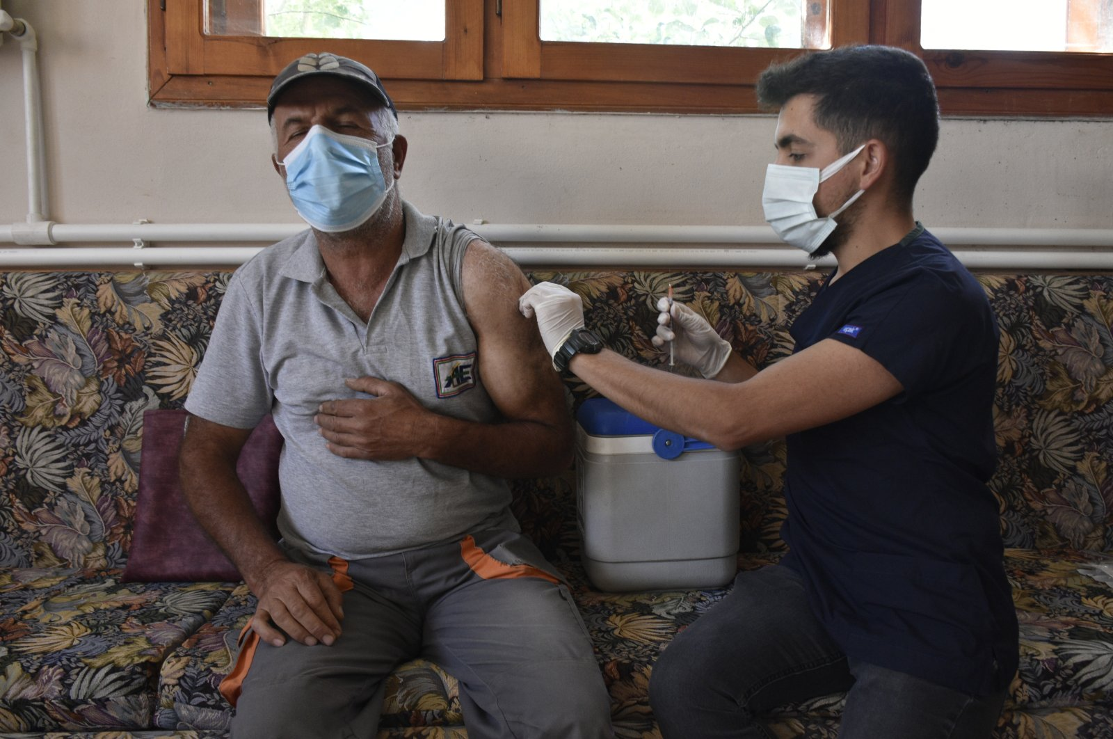 A man is vaccinated at home, in Bayburt, northeastern Turkey, Sept. 17, 2021. (AA Photo)