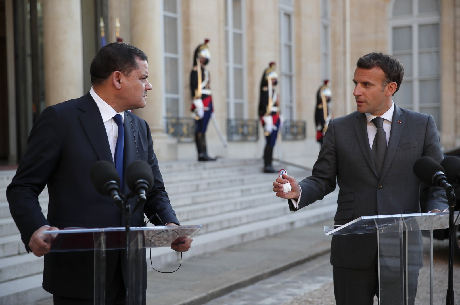 French President Emmanuel Macron (R) and Libyan Prime Minister  Abdul Hamid Mohammed Dbeibah attend a press conference after their meeting at the Elysee Palace in Paris, France, June 1, 2021. (AP File Photo)