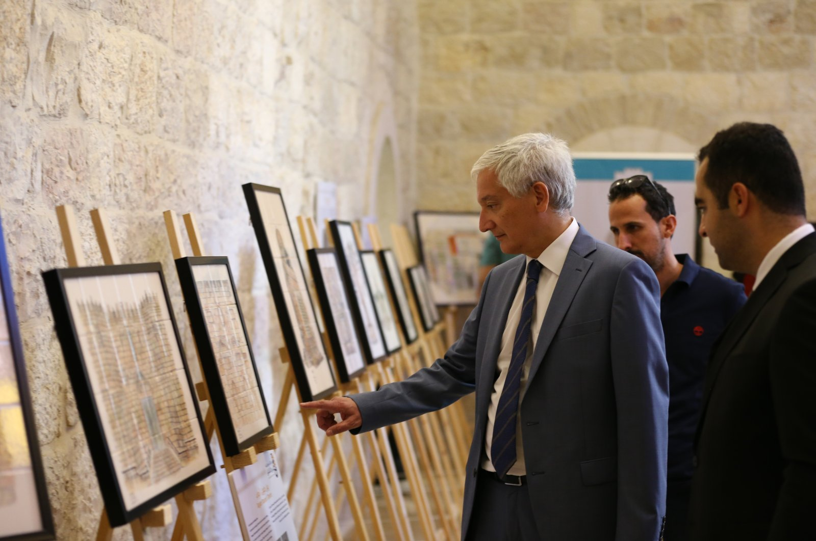 Ahmet Rıza Demirer, Turkey's consul general in Jerusalem, visits an exhibition by Palestinian artists in East Jerusalem, occupied Palestine, Sept. 20, 2021. (AA Photo)