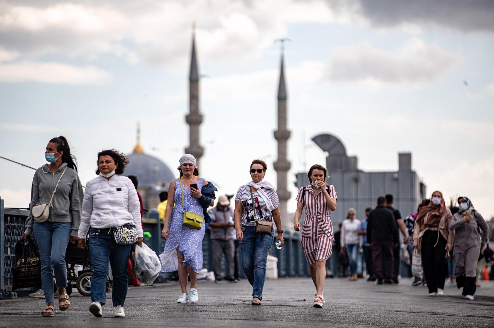 People wearing protective masks walk on the Galata Bridge, in Istanbul, Turkey, Sept. 6, 2021. (Reuters Photo)