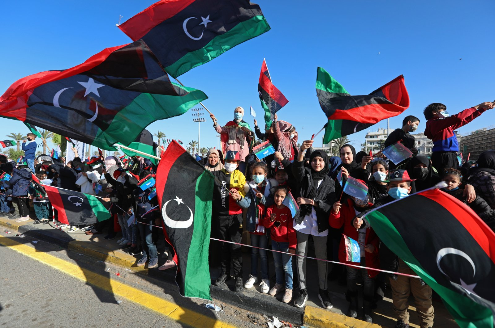 Under tight security, Libyans mark the 10th anniversary of their 2011 uprising that led to the overthrow and killing of longtime ruler Moammar Gadhafi in Martyrs Square, Tripoli, Libya, Feb. 17, 2021. (AP File Photo)