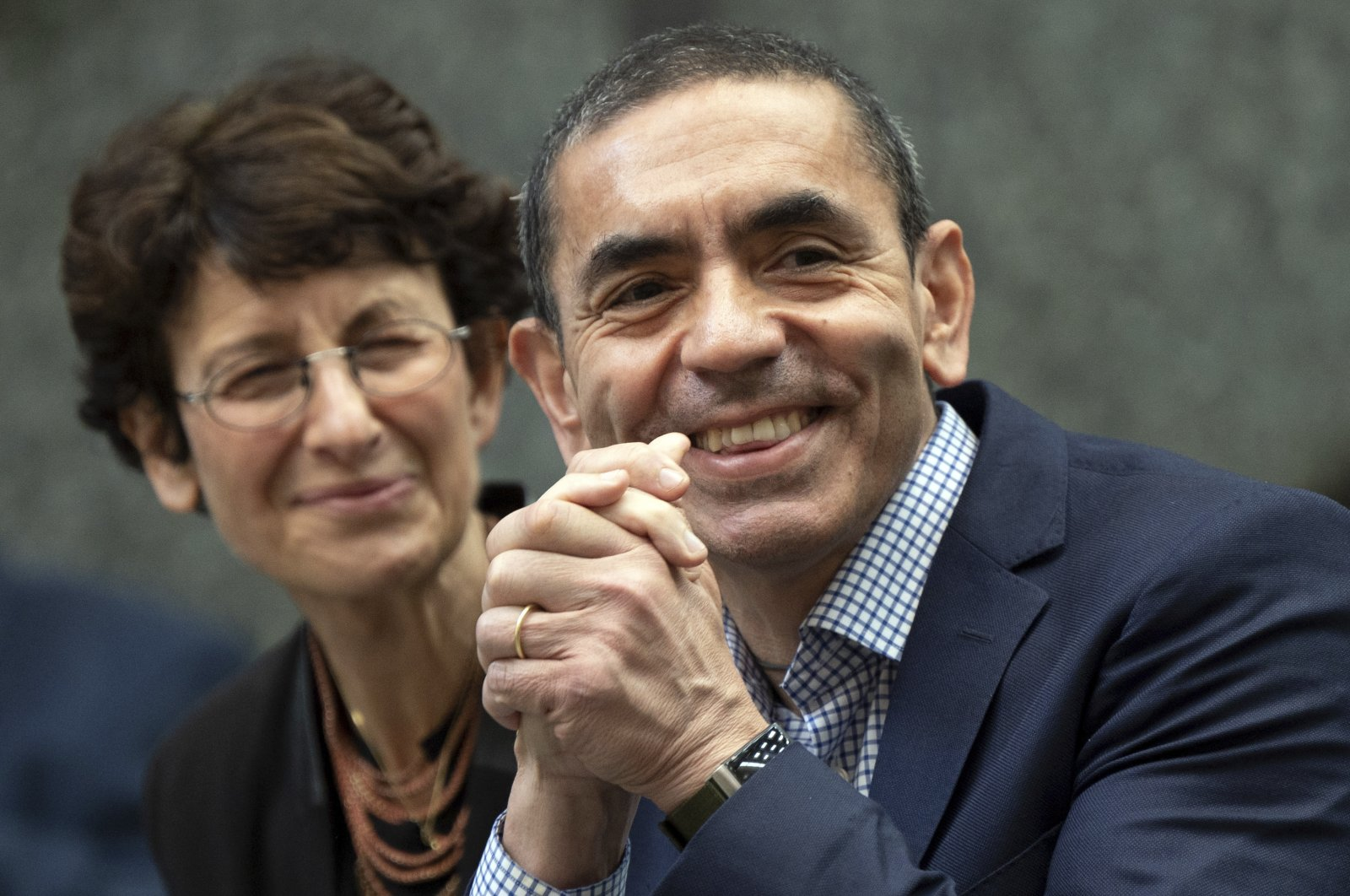 Özlem Türeci (L) and Uğur Şahin sit in the front row in Cologne, Germany, Sept. 17, 2021. (AP Photo)