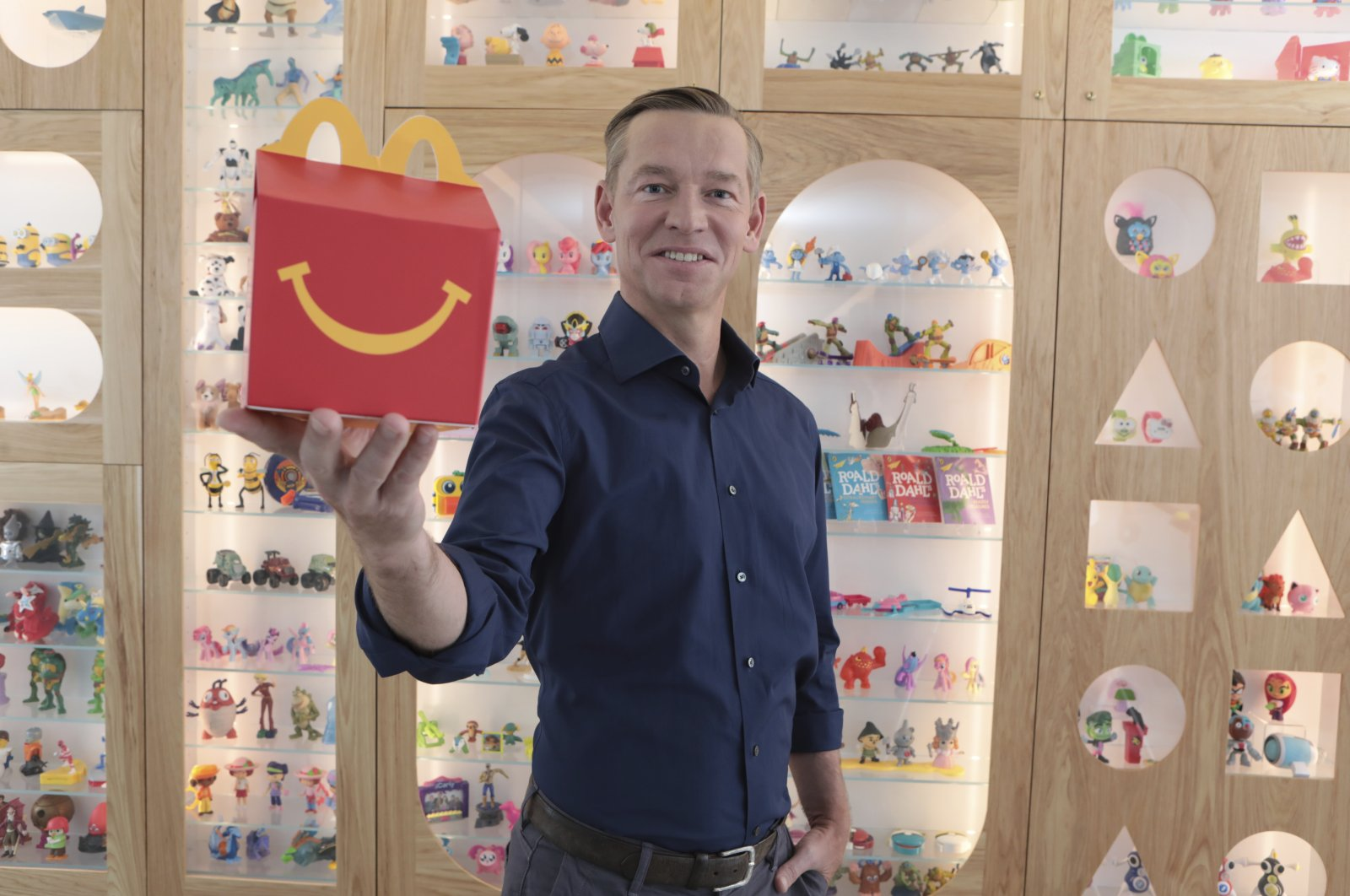 McDonald's CEO Chris Kempczinski with a Happy Meal at McDonald's Headquarters, Chicago, U.S., Aug 13, 2021. (Jean-Marc Giboux/AP Images for McDonald's Corporation)