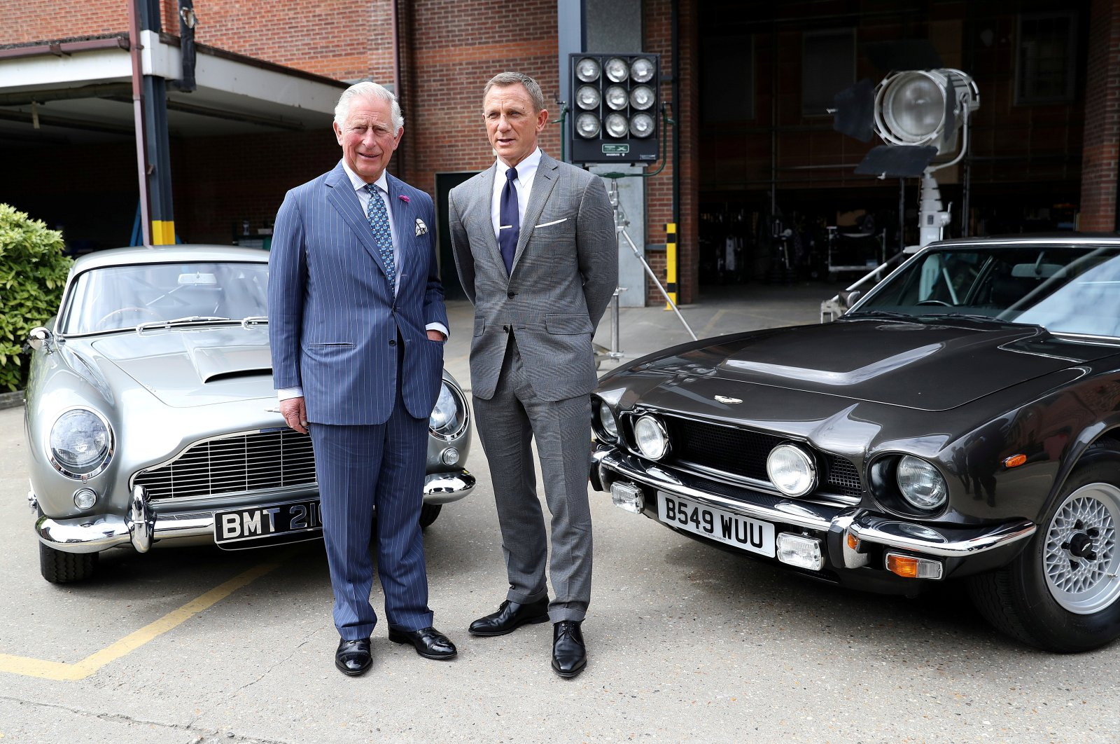 Prince Charles poses with British actor Daniel Craig as he tours the set of the 25th James Bond Film at Pinewood Studios in Iver Heath, Buckinghamshire, Britain June 20, 2019. (REUTERS Photo)