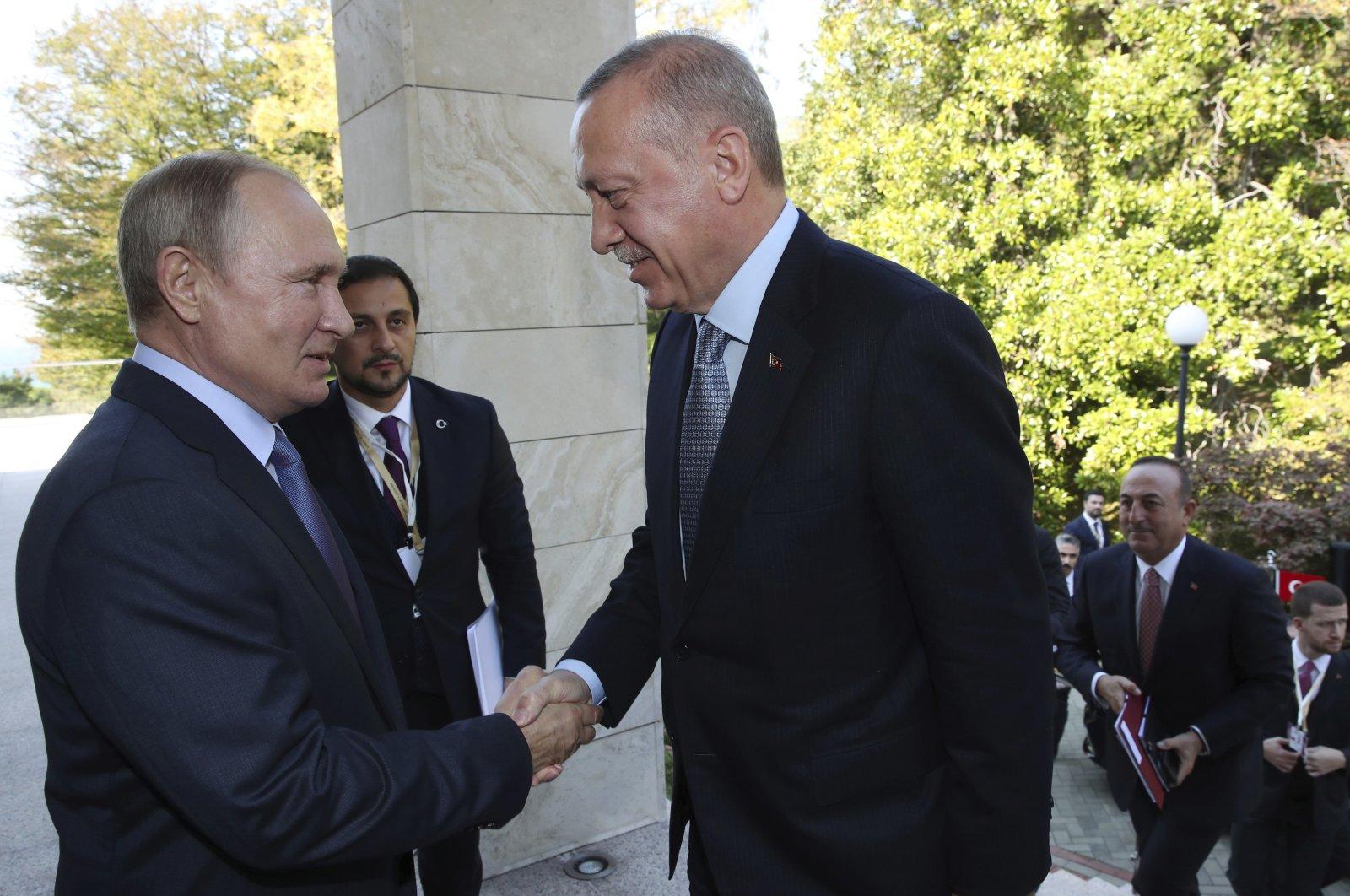 Russian President Vladimir Putin (L) and Turkish President Recep Tayyip Erdoğan shake hands before their meeting in the Bocharov Ruchei residence in the Black Sea resort of Sochi, Russia, Oct. 22, 2019. (AP Photo)
