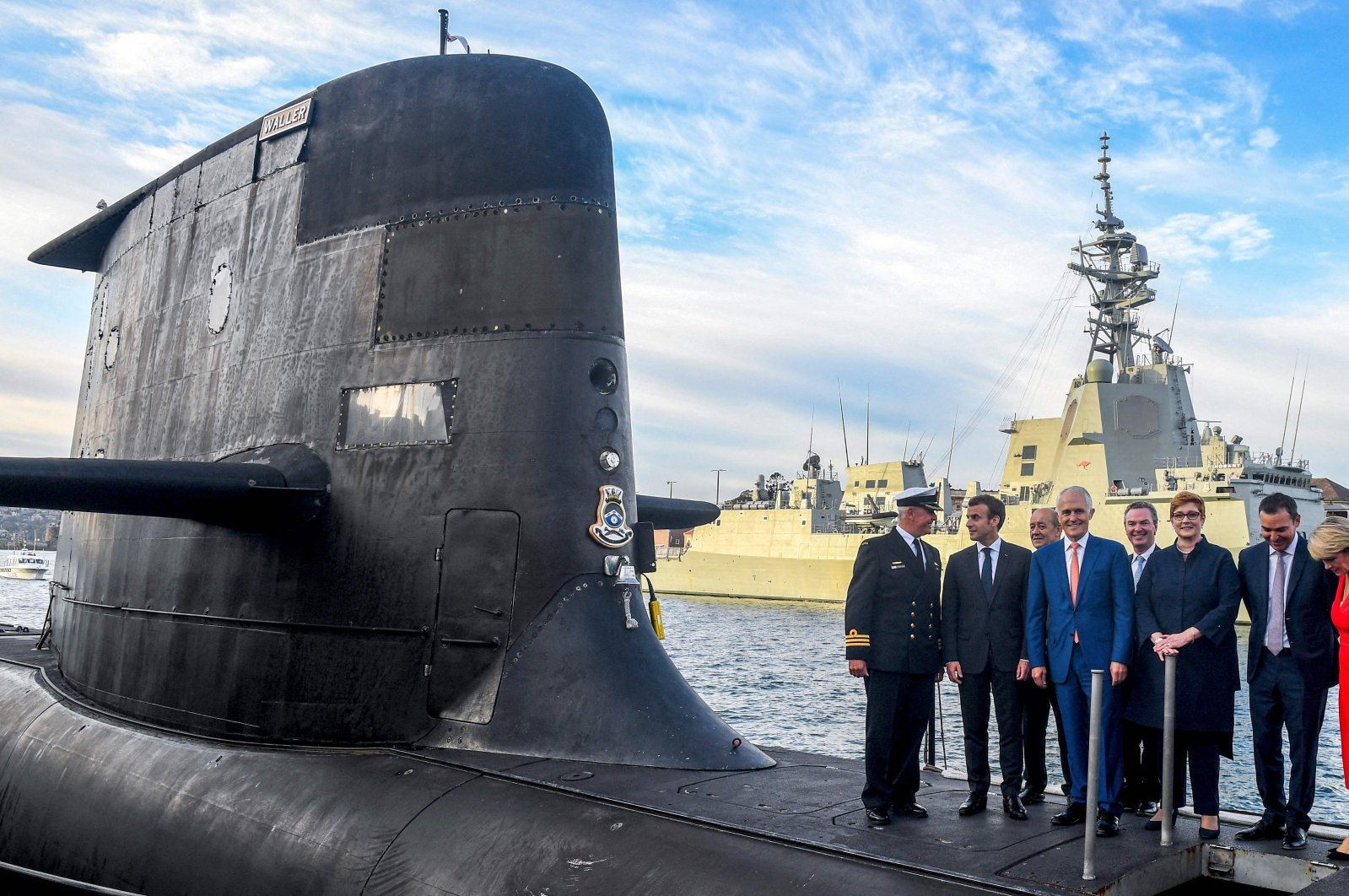 French President Emmanuel Macron (2nd L) and Australian Prime Minister Malcolm Turnbull (C) standing on the deck of HMAS Waller, a Collins-class submarine operated by the Royal Australian Navy, at Garden Island in Sydney, Australia, May 2, 2018. (AFP Photo)
