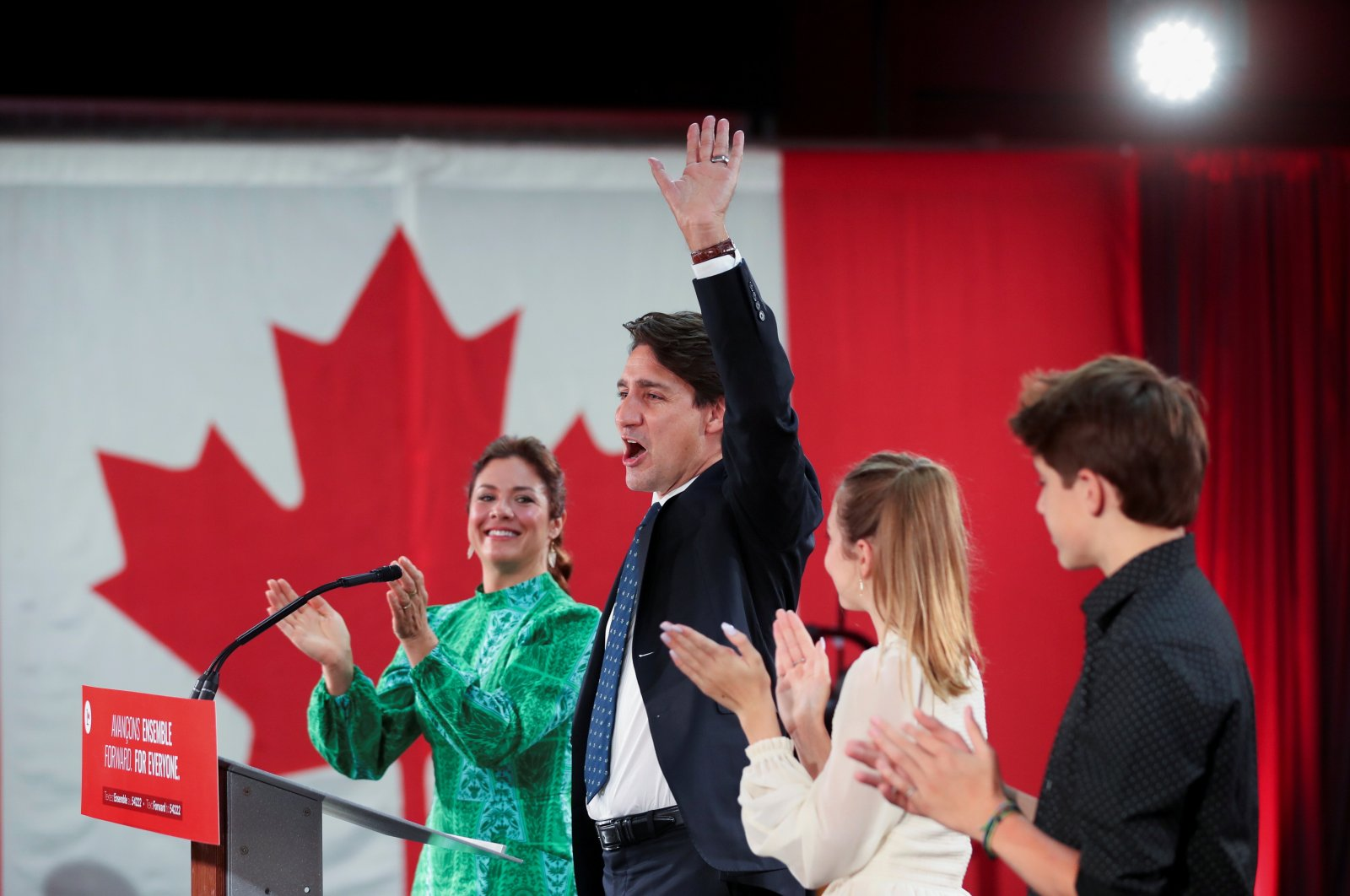 Canada's Liberal Prime Minister Justin Trudeau, accompanied by his wife Sophie Gregoire and their children Ella-Grace and Xavier waves to supporters during the Liberal election night party in Montreal, Quebec, Canada, Sept. 21, 2021. (REUTERS)