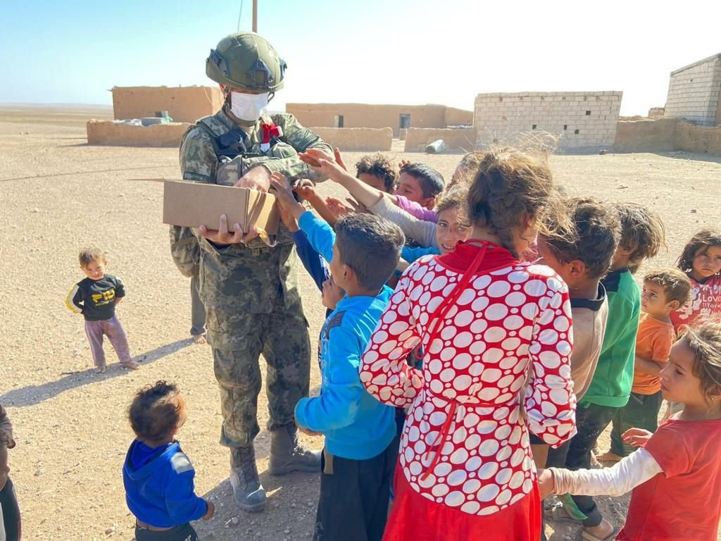 Turkish soldiers distribute aid in the Operation Peace Spring zone in northern Syria, Sept. 22, 2021. (AA Photo)