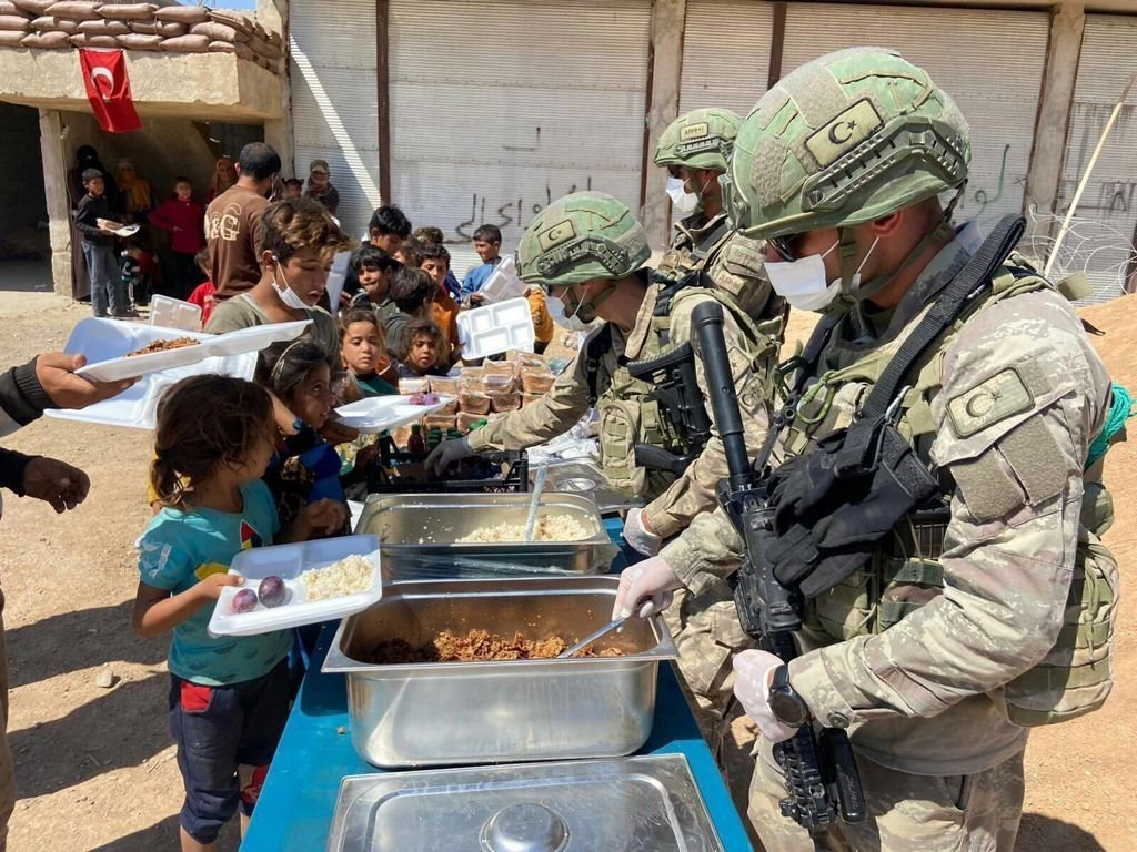 Turkish soldiers distribute food in the Operation Peace Spring zone in northern Syria, Sept. 22, 2021. (AA Photo)
