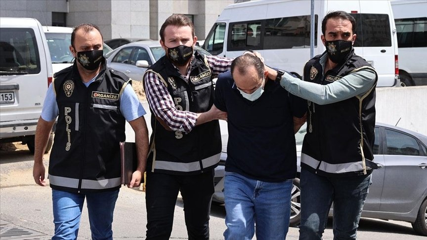 Police officers escort Ibrahim Tatar, a top FETÖ figure caught in a safe house, in Istanbul, Turkey, May 4, 2021. (AA PHOTO)